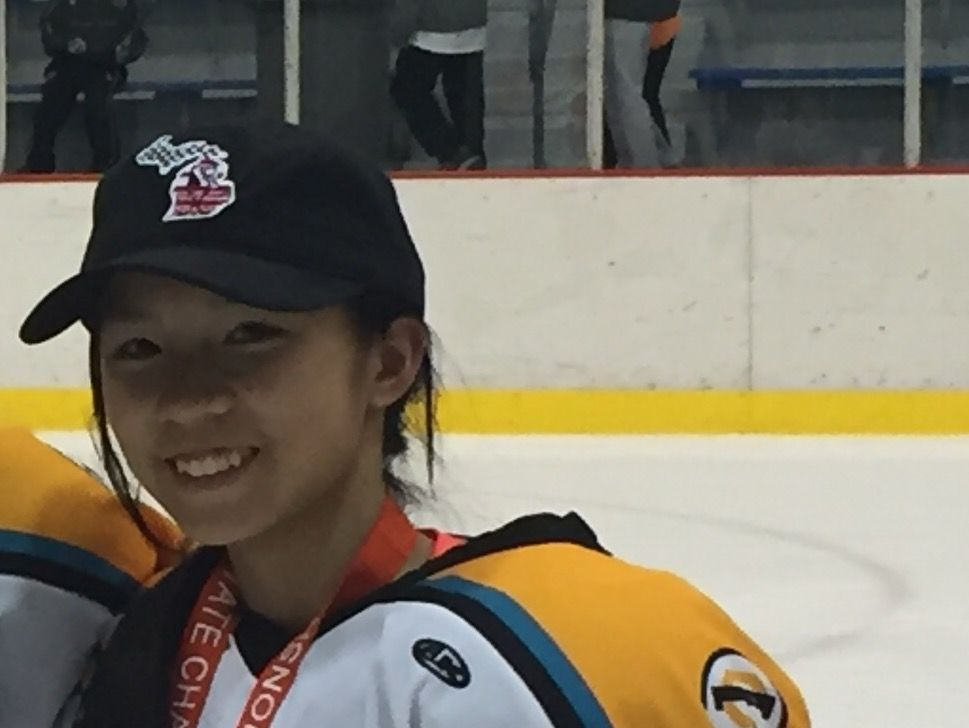 MaryClaire Shorkey poses after winning the Michigan Amateur Hockey Association state championship.