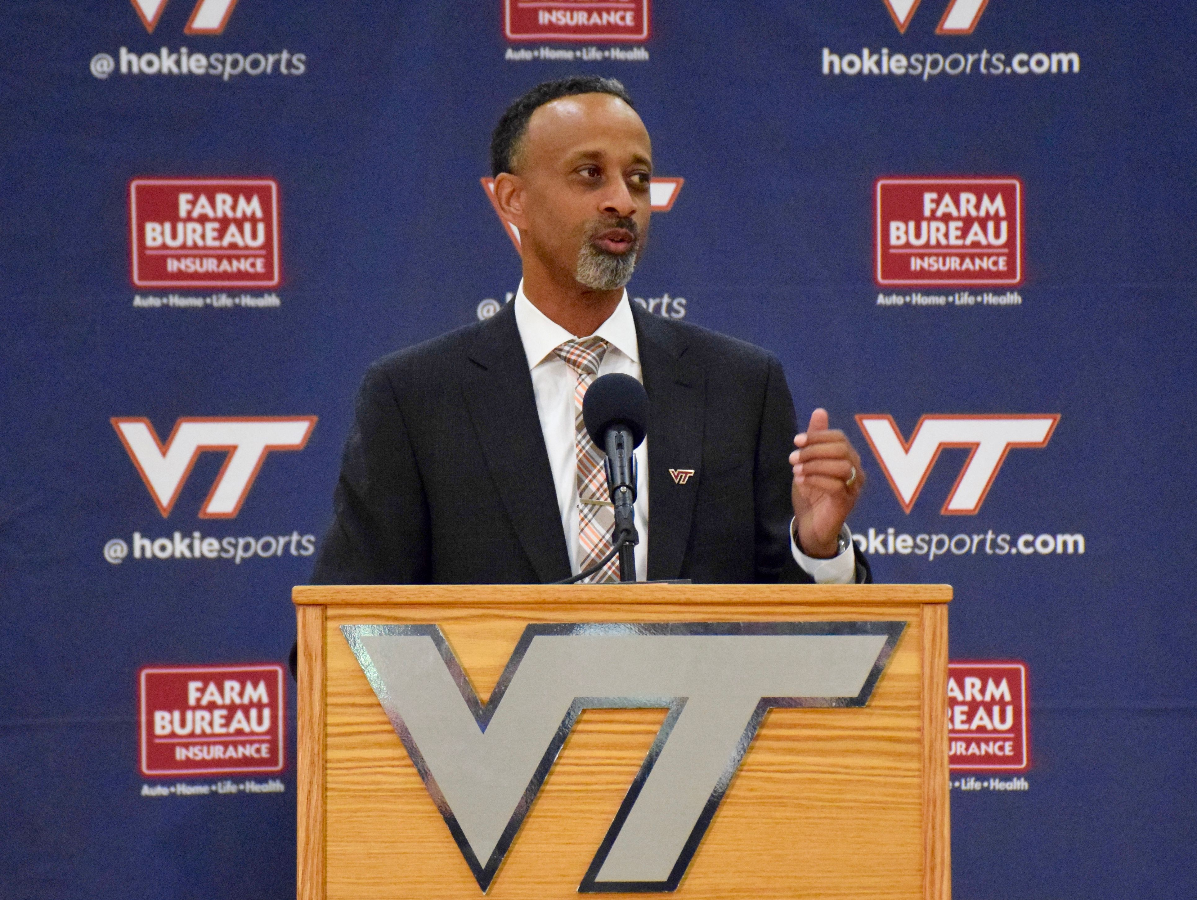 Kenny Brooks, Virginia Tech's new women's basketball coach, speaks to the media at his introductory press conference Wednesday n Blacksburg.