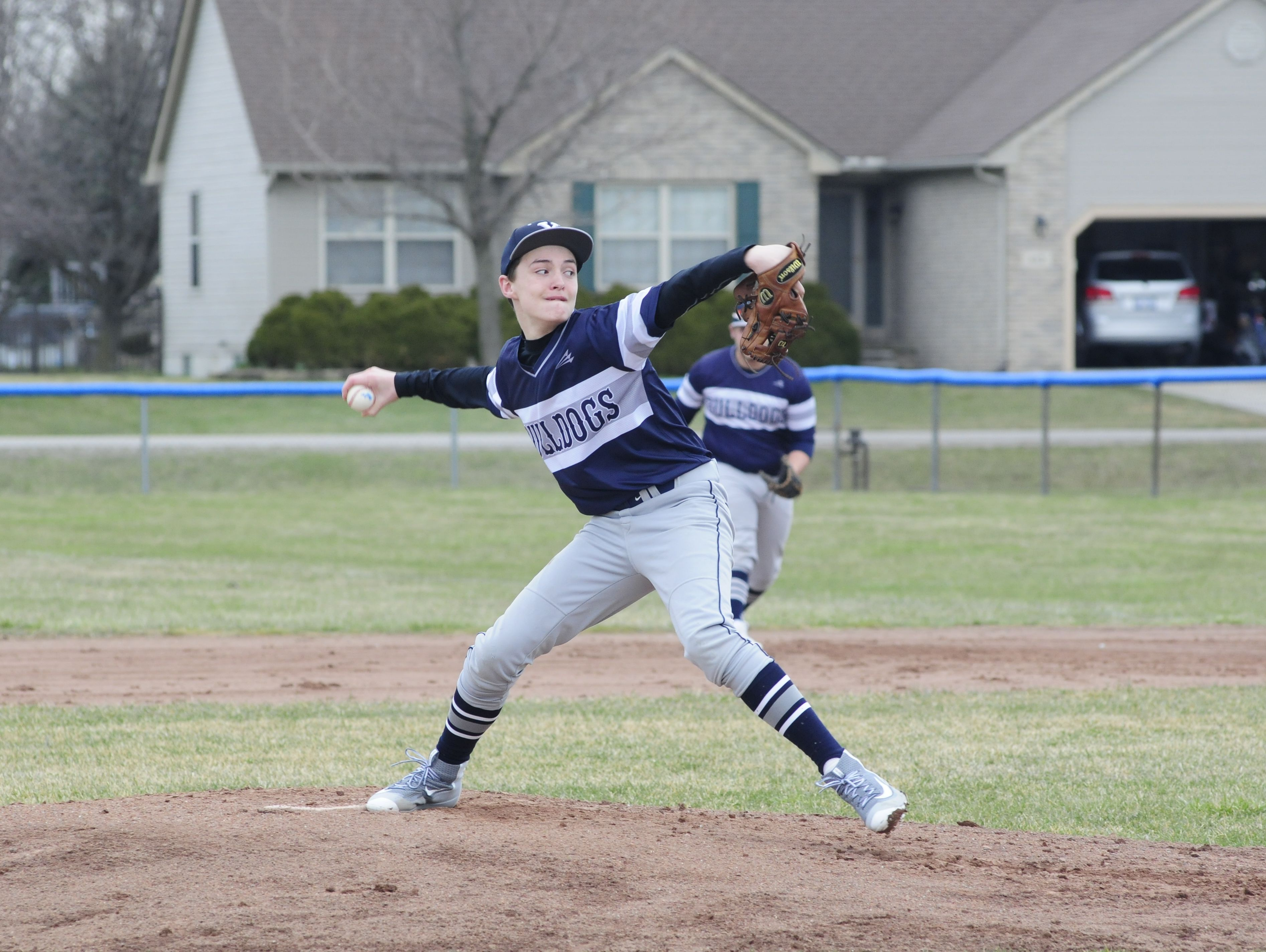 Yale sophomore Ryan Korolden throws a pitch against St. Clair on March 30, 2016 at St. Clair High School.