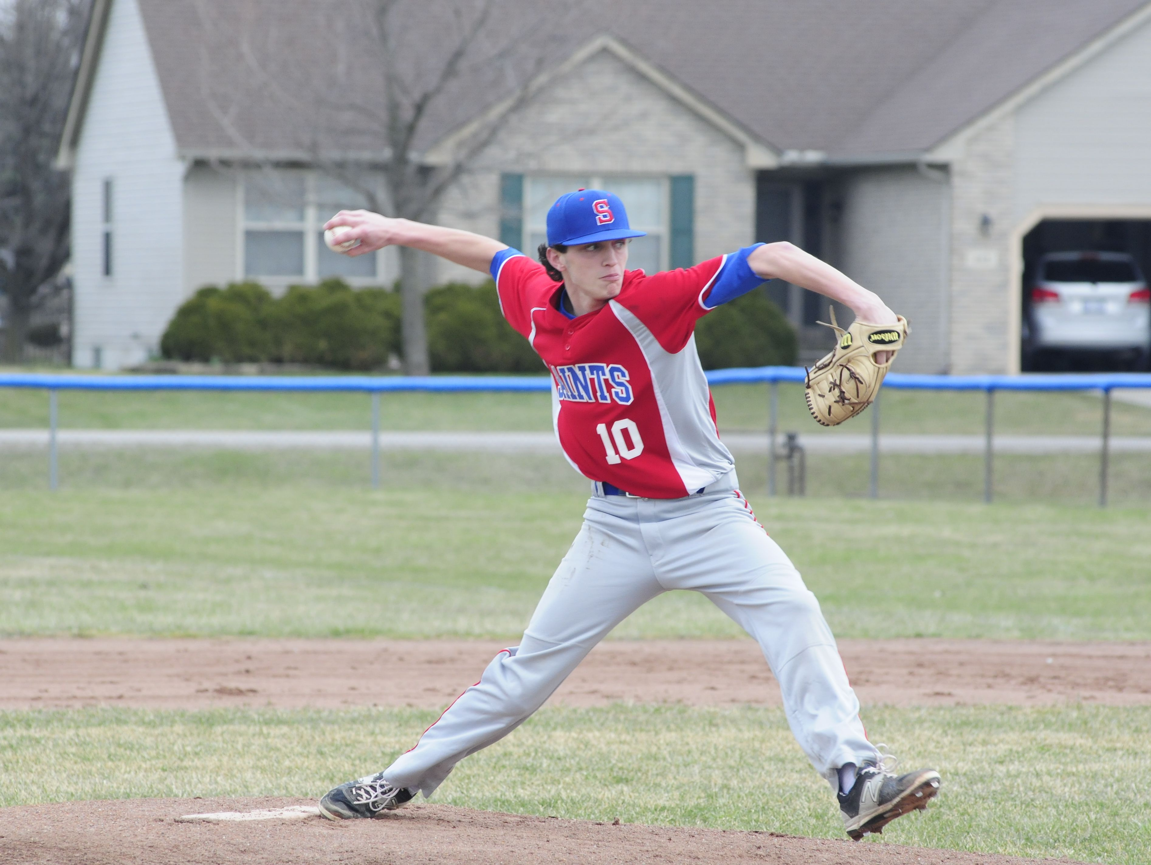 St. Clair sophomore Ian Janssen throws a pitch in the first inning against Yale on March 30, 2016 at St. Clair High School.