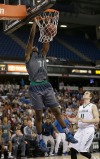 Chino Hills' Onyeka Okongwu, left, hangs on the rim after stuff against (Photo: Rich Pedroncelli, Associated Press)