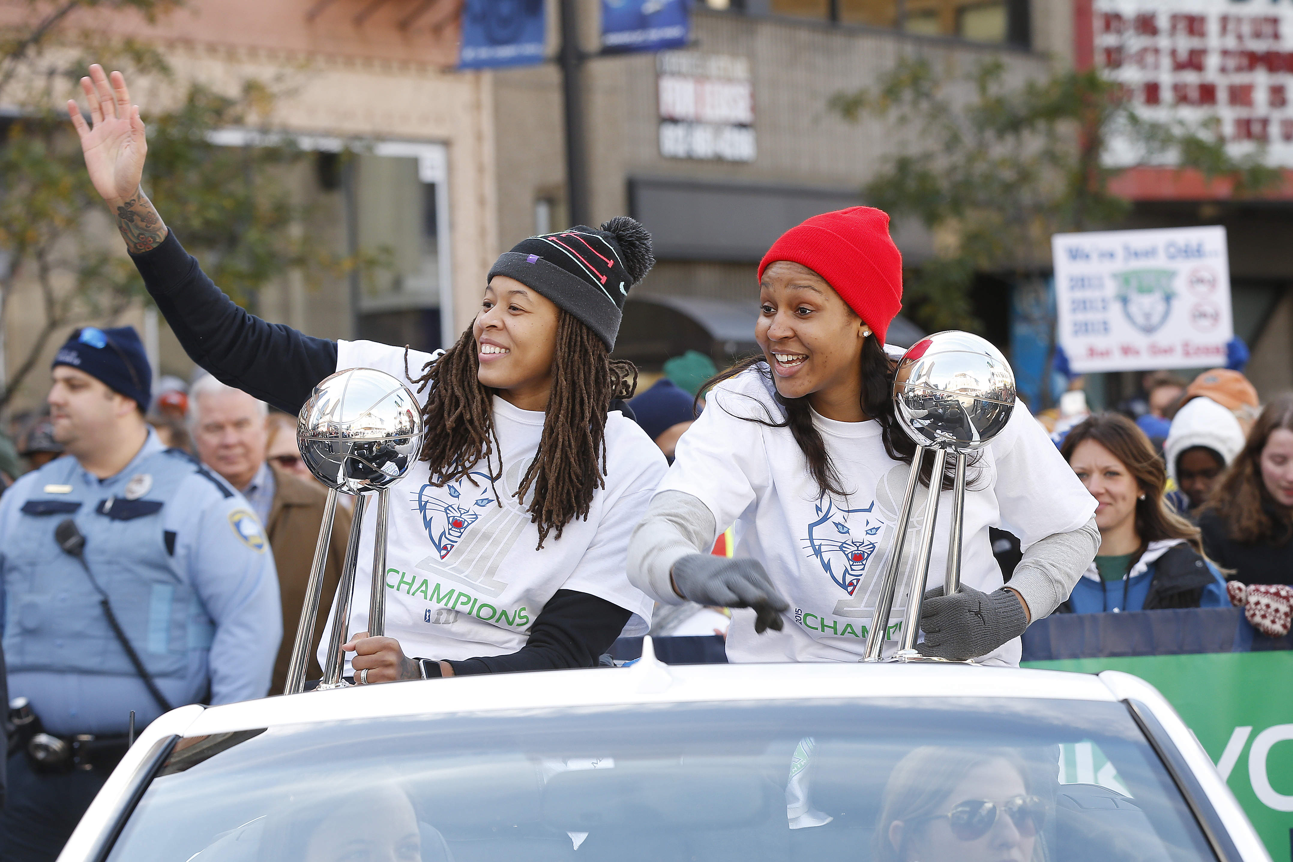 Minnesota Lynx basketball players Seimone Augustus, (left) and Maya Moore, right, wave to fans during a parade to celebrate the teams WNBA Championship (Photo: Stacy Bengs, Associated Press)