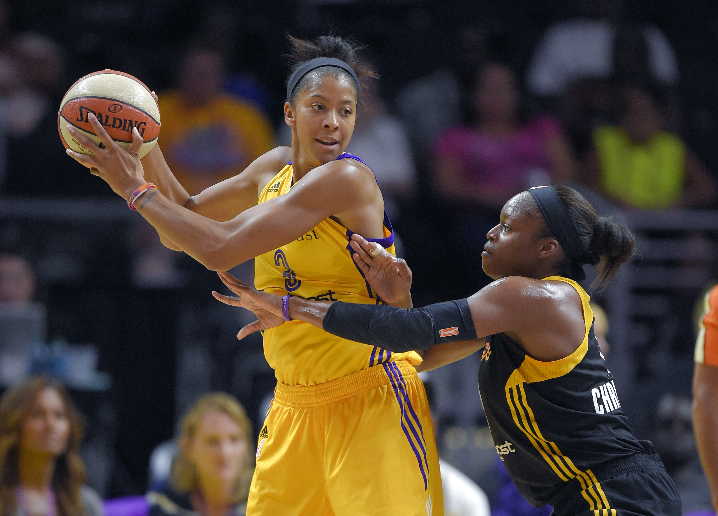 Los Angeles Sparks forward Candace Parker (left) tries to get past Tulsa Shock forward Karima Christmas (Photo: Mark J. Terrill, Associated Press)