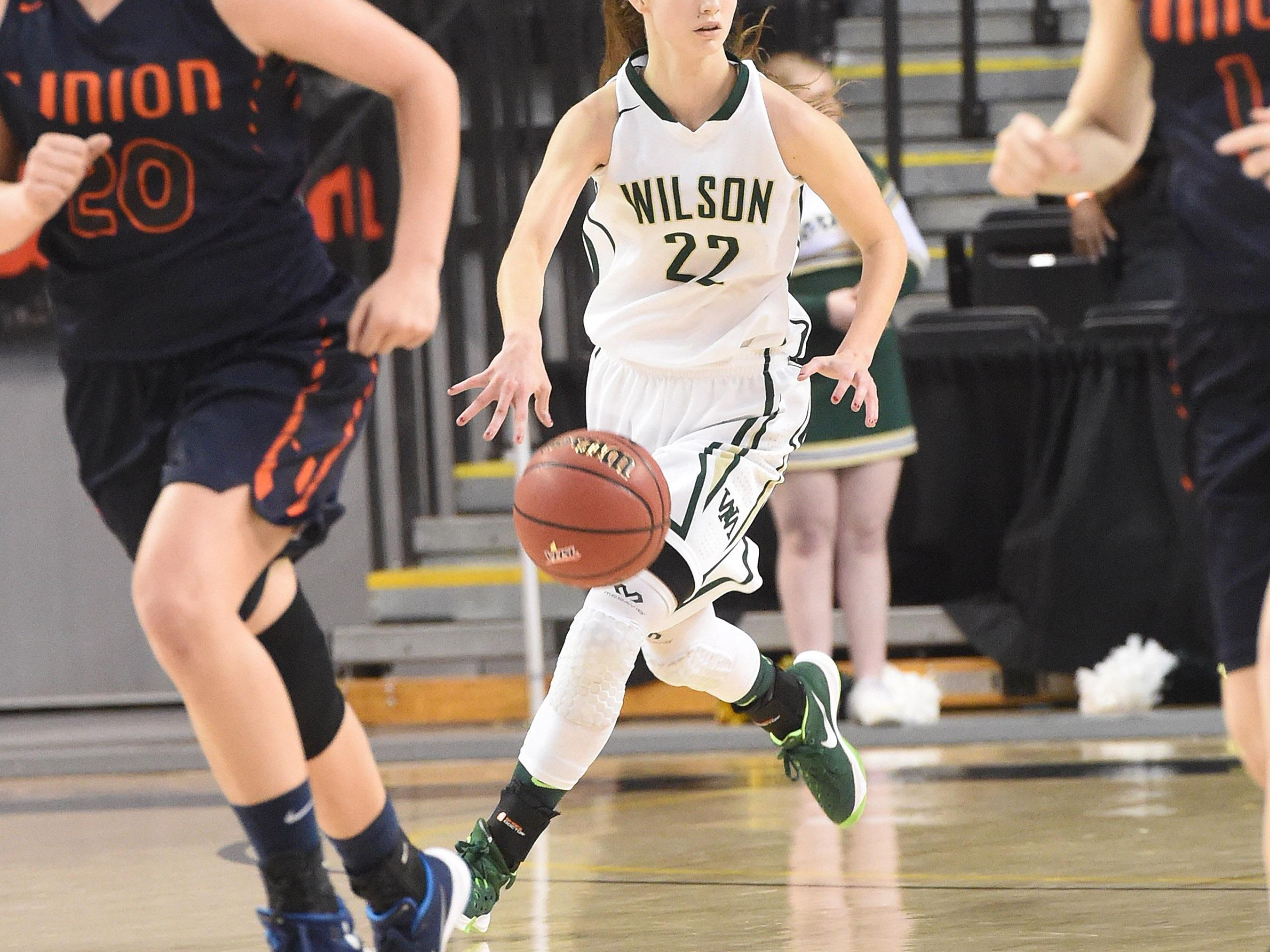 Wilson Memorial's Lexi Deffenbaugh takes the ball downcourt during the Group 2A state semifinals played in Richmond on Thursday, March 10, 2016. Wilson lost to Union, 54-41.