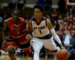 New Albany's Romeo Langford moves the ball against Southport's Harold Bennett during the Class 4A semistate championship Saturday, March 19, 2016, in the Tiernan Center at Richmond High School.