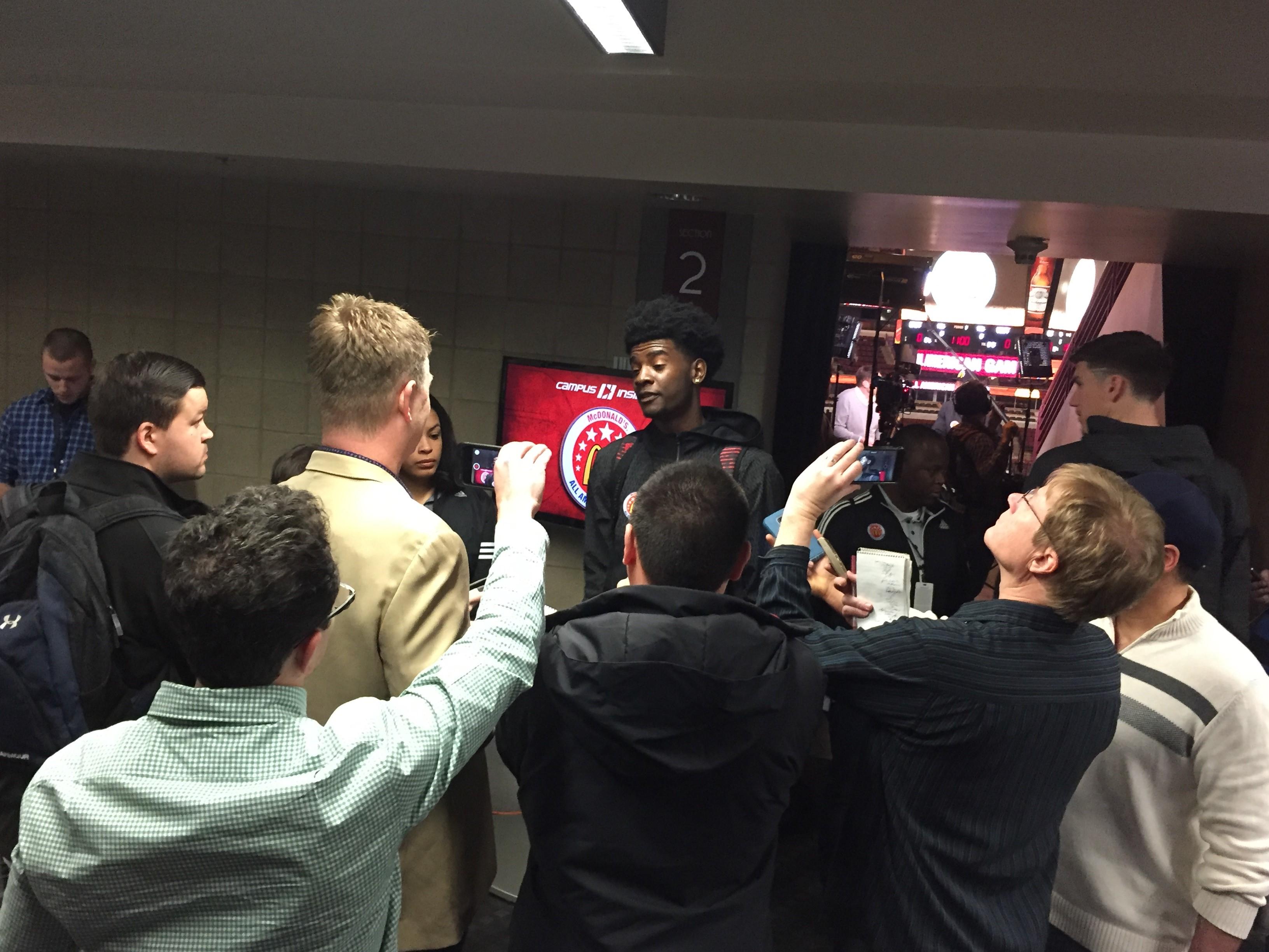 Josh Jackson gets swarmed by reporters at McDonald's AA media day. (Photo: Jason Jordan)