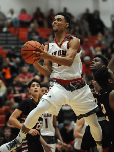 New Albany's Josh Jefferson (25) drives and shoots against Evansville Harrison on Saturday at New Albany High School. Photo by David Lee Hartlage/Special to the Courier-journal. Dec. 05, 2015