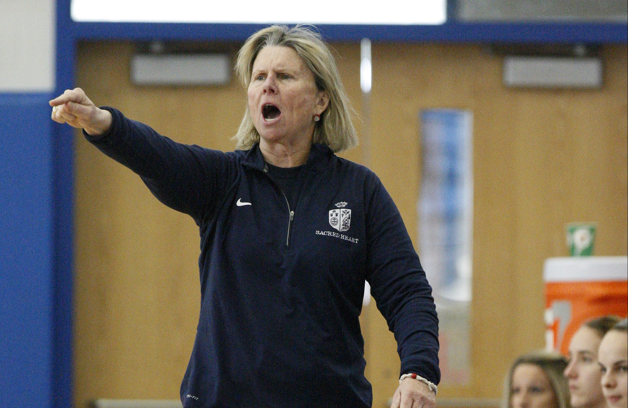 Sacred Heart head coach Donna Moir instructs her team against Male during their 7th Region Tournament game at Valley High School. Mar. 2, 2016