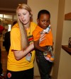 McDonald's All American forward Lauren Cox goes on an Easter egg hunt with Stanley Parchman who lives at the Ronald McDonald House in downtown Chicago. (Photo: Brian Spurlock, USA TODAY Sports)
