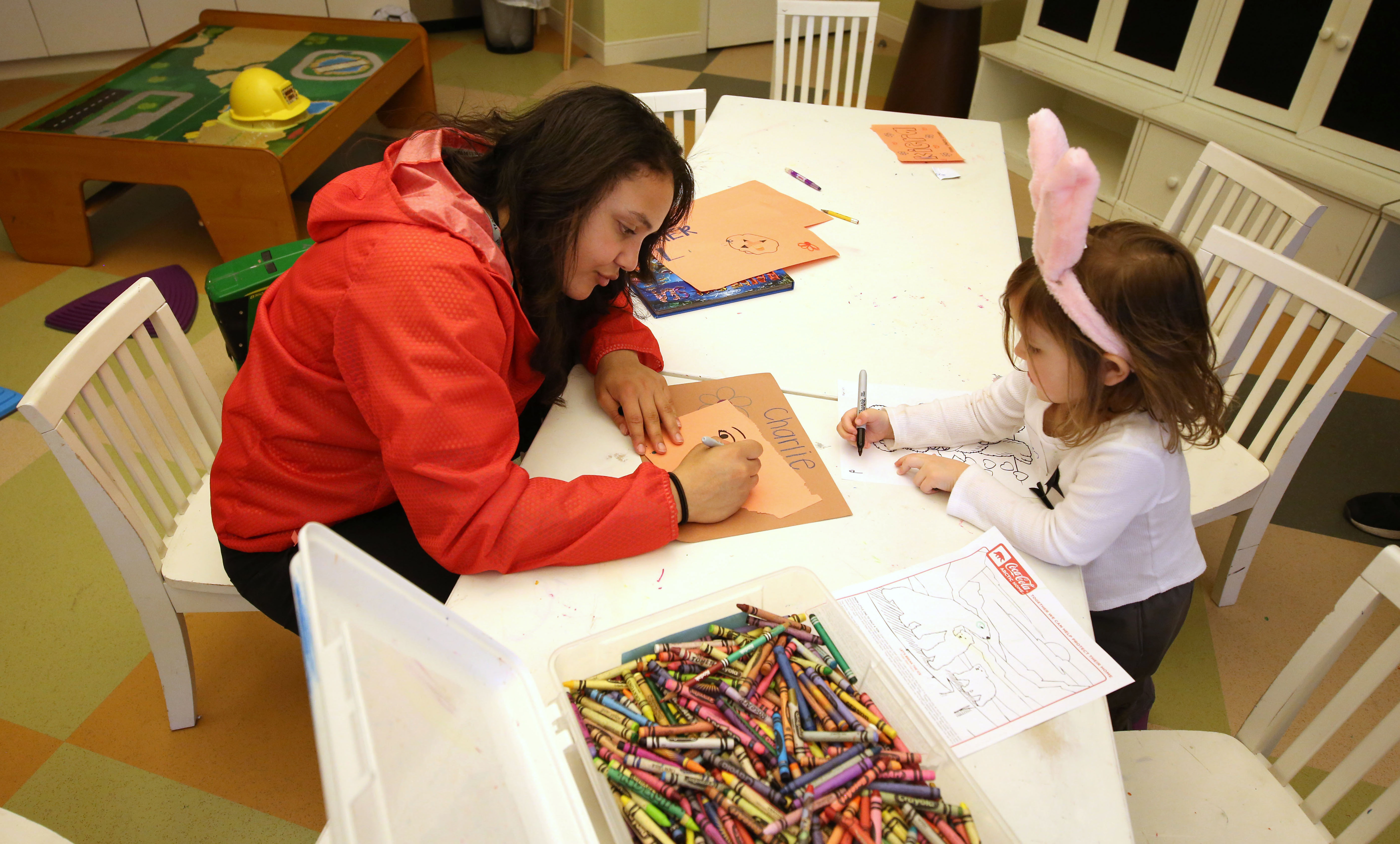 Destiny Slocum colors with a child during her visit to the Ronald McDonald House (Photo: Brian Spurlock. USA TODAY Sports)