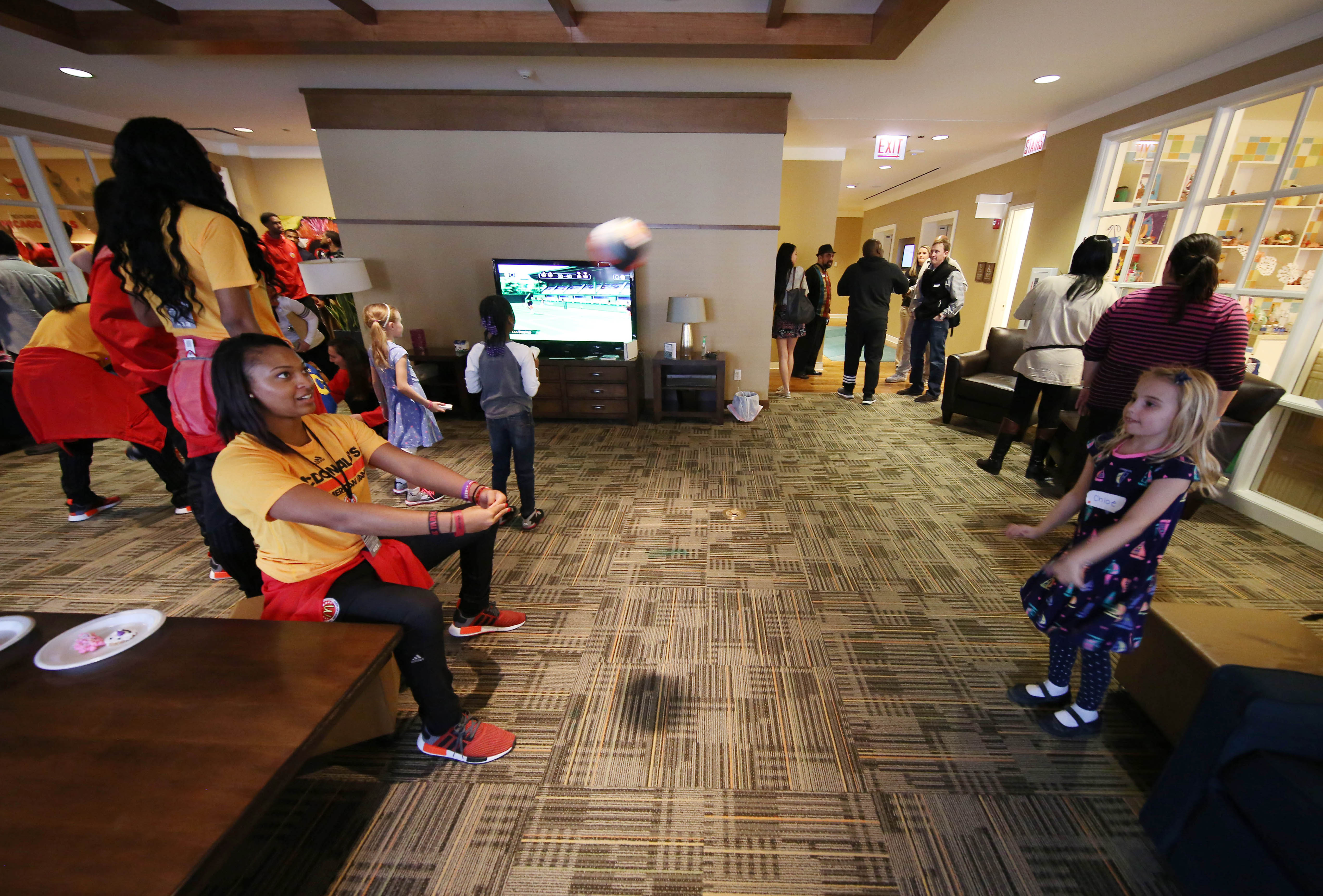 DiJonai Carrington (left) plays catch with a child during a visit to the Ronald McDonald House in downtown Chicago. (Photo credit: Brian Spurlock, USA TODAY Sports)