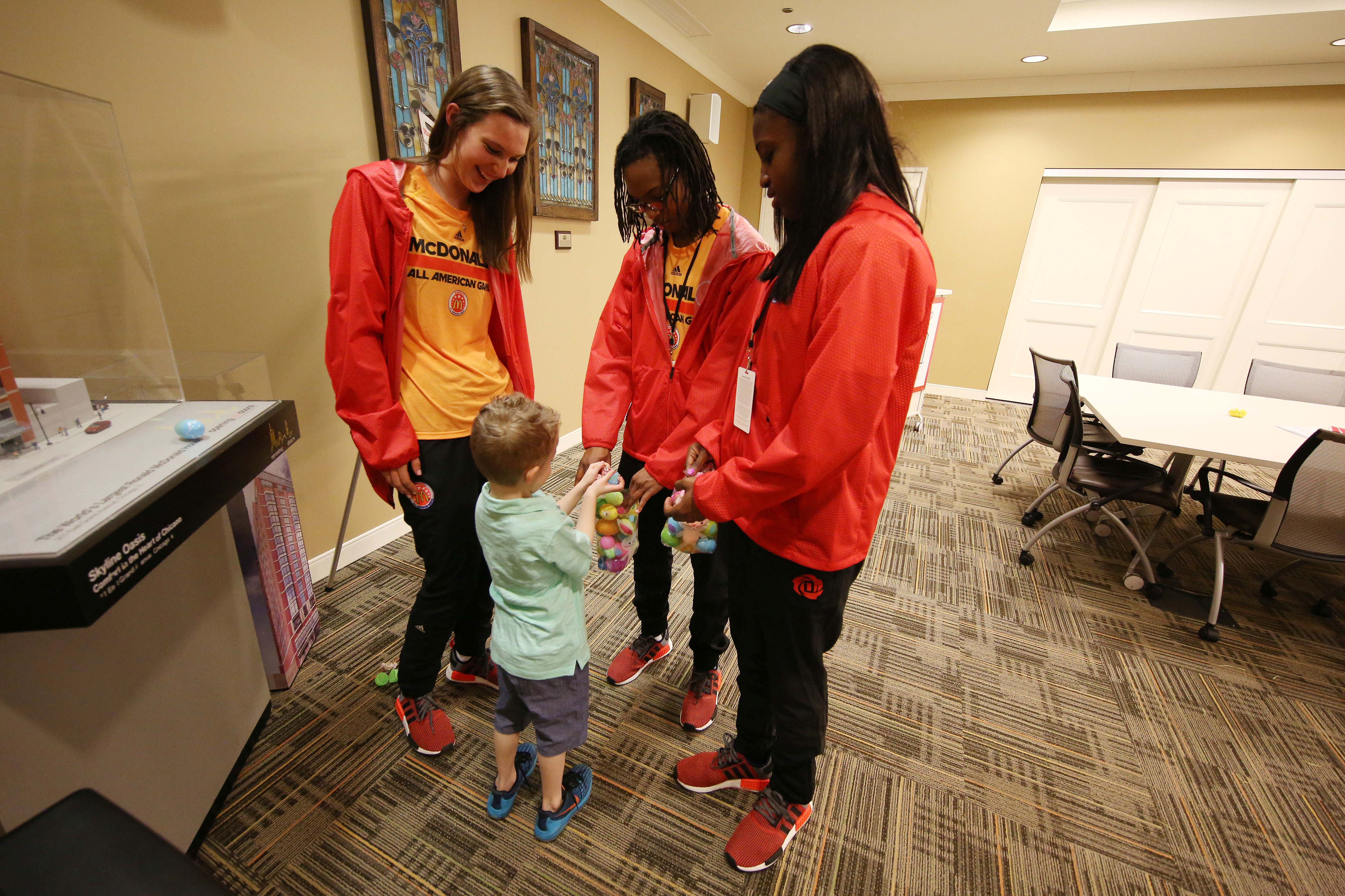 Forward Jeannie Boehm and wing Chassity Lea Lea Carter and guard Jackie Young participate in an Easter egg hunt with Bradley Godish during their visit to the Ronald McDonald House (Photo: Brian Spurlock, USA TODAY Sports)