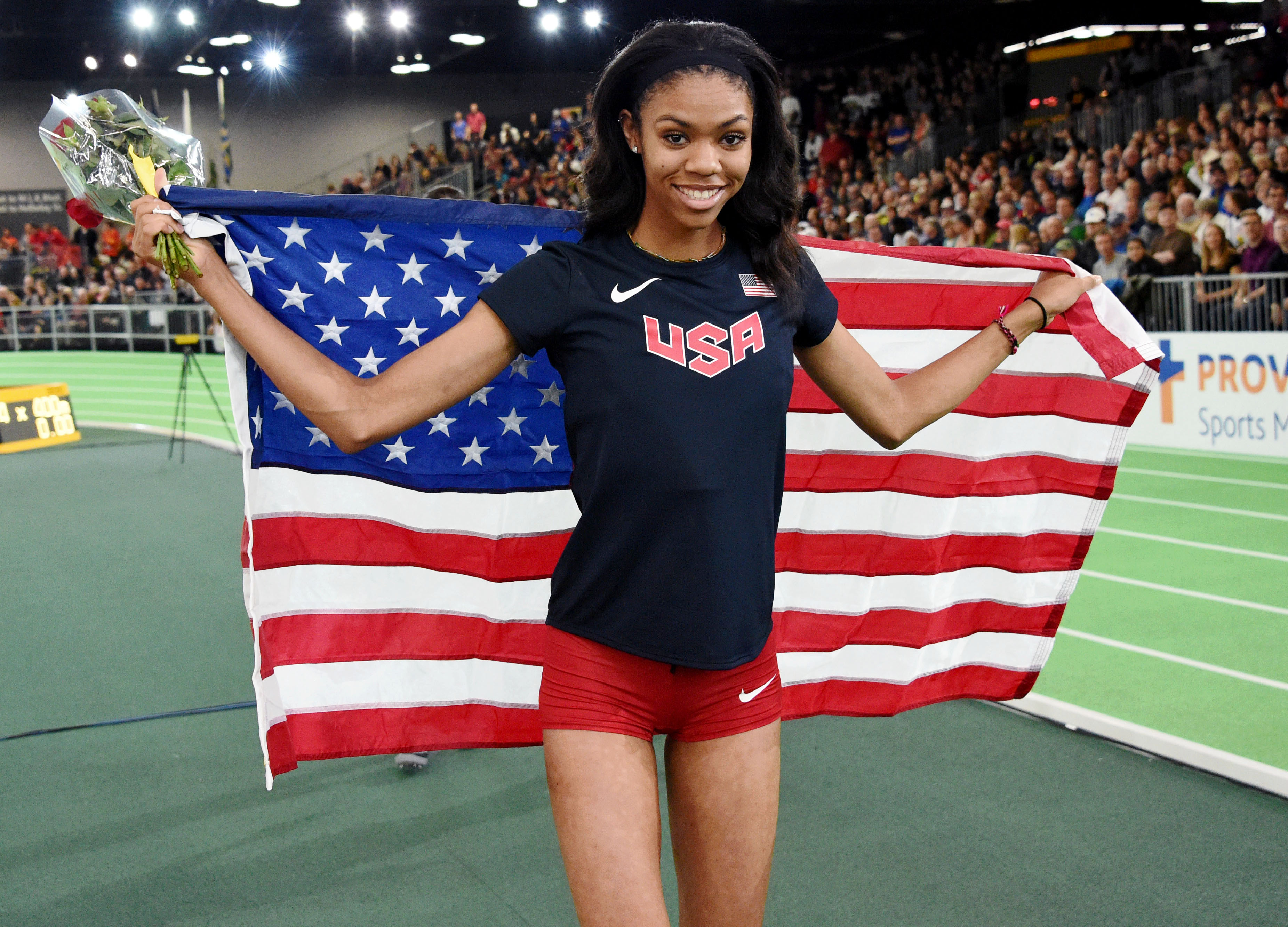 Vashti Cunningham poses with the flag after winning the women's high jump during the 2016 IAAF World Championships. (Photo: Kirby Lee, USA TODAY Sports)