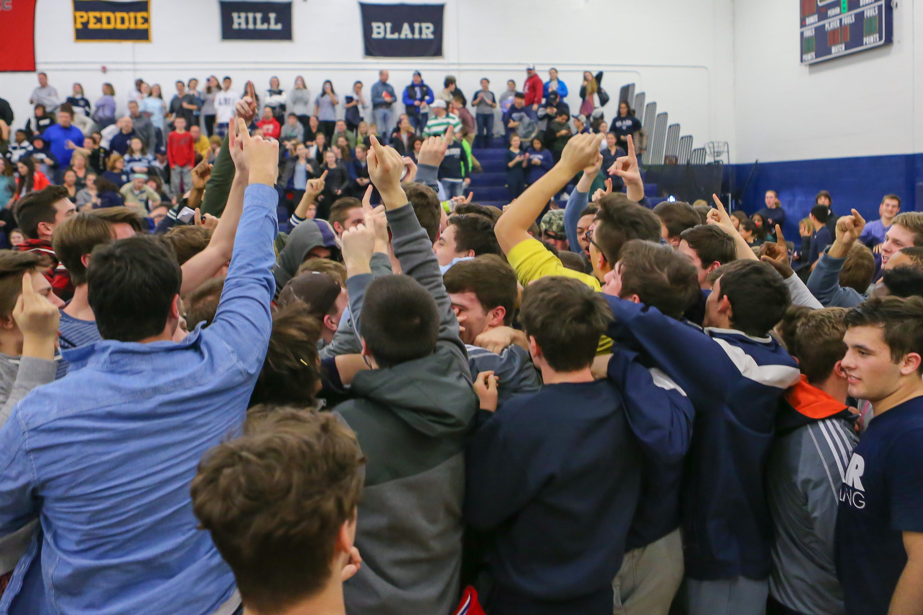 Blair Academy students and wrestler storm the mat after their 35-20 victory over Wyoming Seminary. (Photo: Vincent Carchietta. USA TODAY Sports)