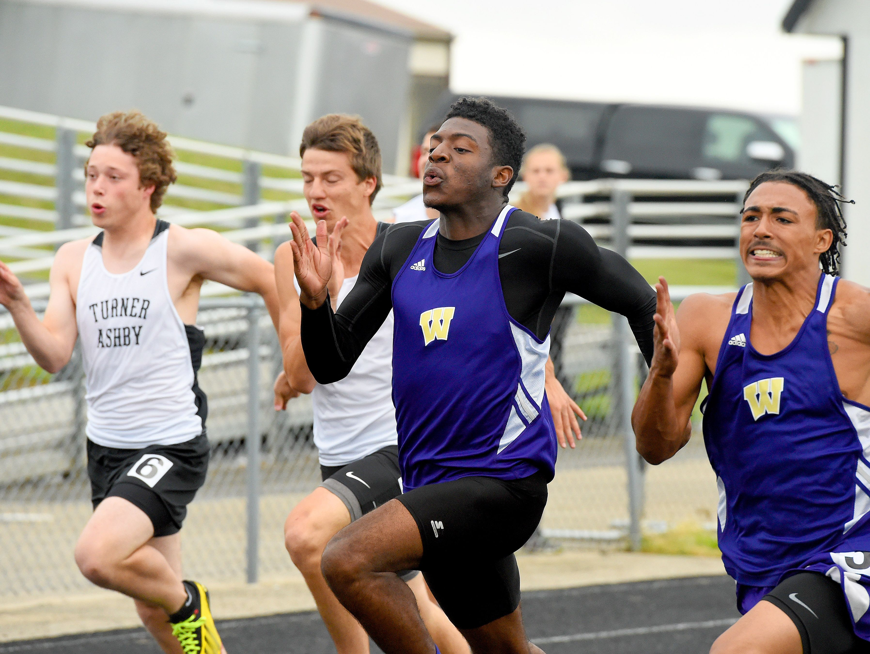 Waynesboro's DeVante Robinson, center, won the 100 in Conference 29, placed fifth in the 200 at the Group 3A West meet and ran a leg on the Little Giants' 4x100 team that placed fifth in Group 3A.