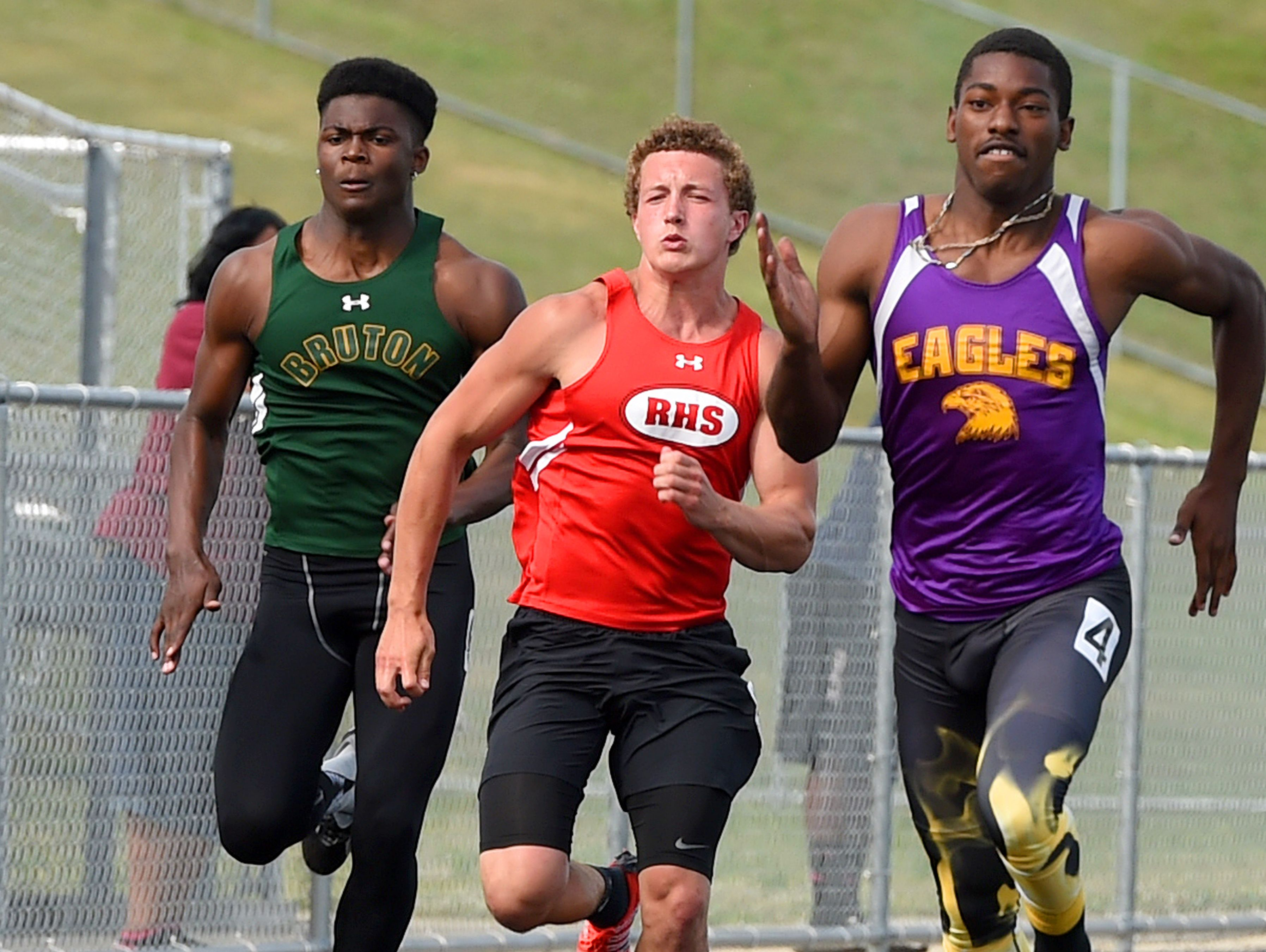 Riverheads' Landon Diehl (center) competes in the boys' 100 meter dash trials. The Region 2A East track and field championships were held at East Rockingham High School near Elkton on Wednesday, May 27, 2015.