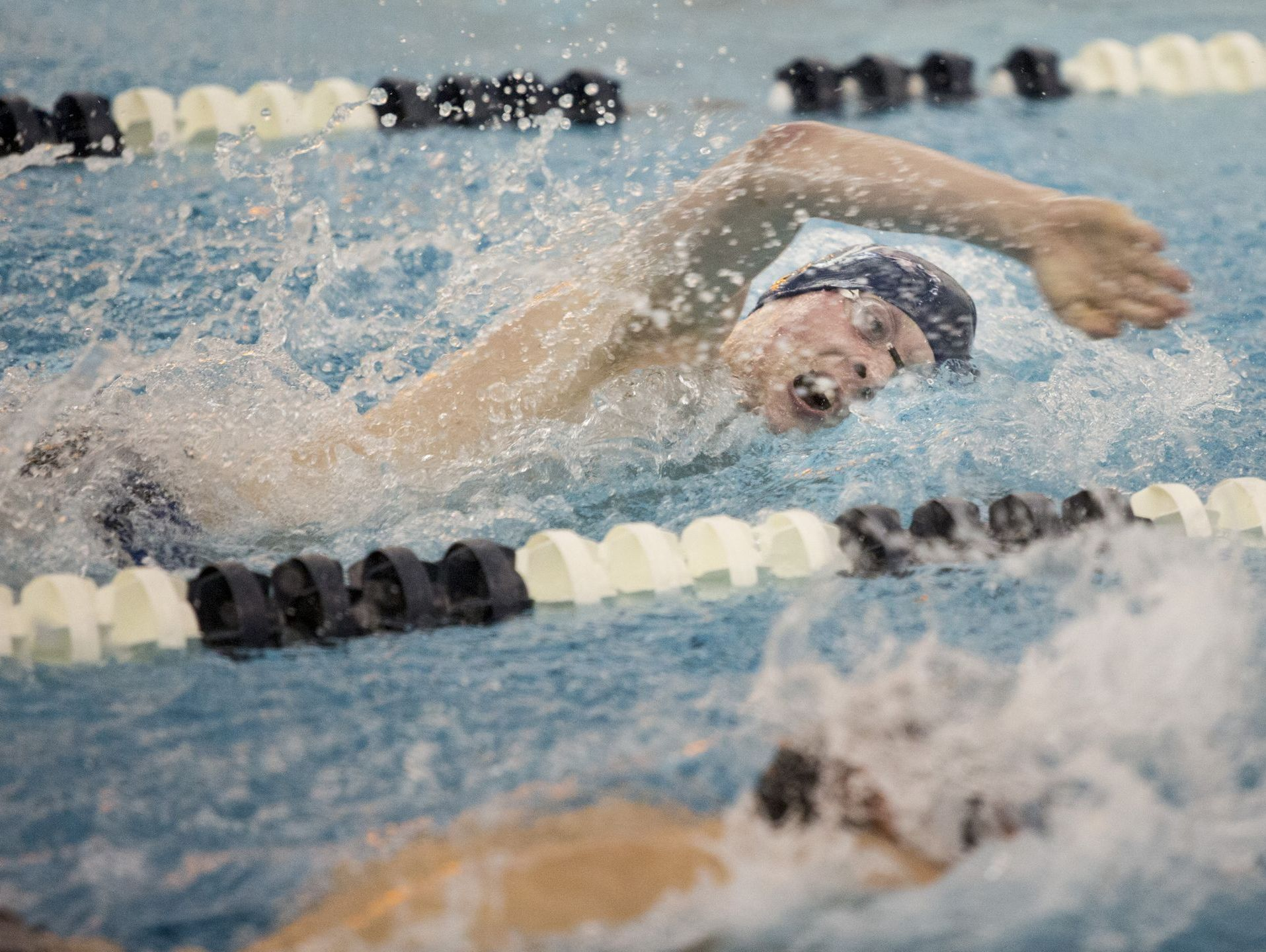 Marysville's Michael Rasnick competes in the 100 yard freestyle during a swim meet Tuesday, Feb. 9, 2016 at Marysville High School.