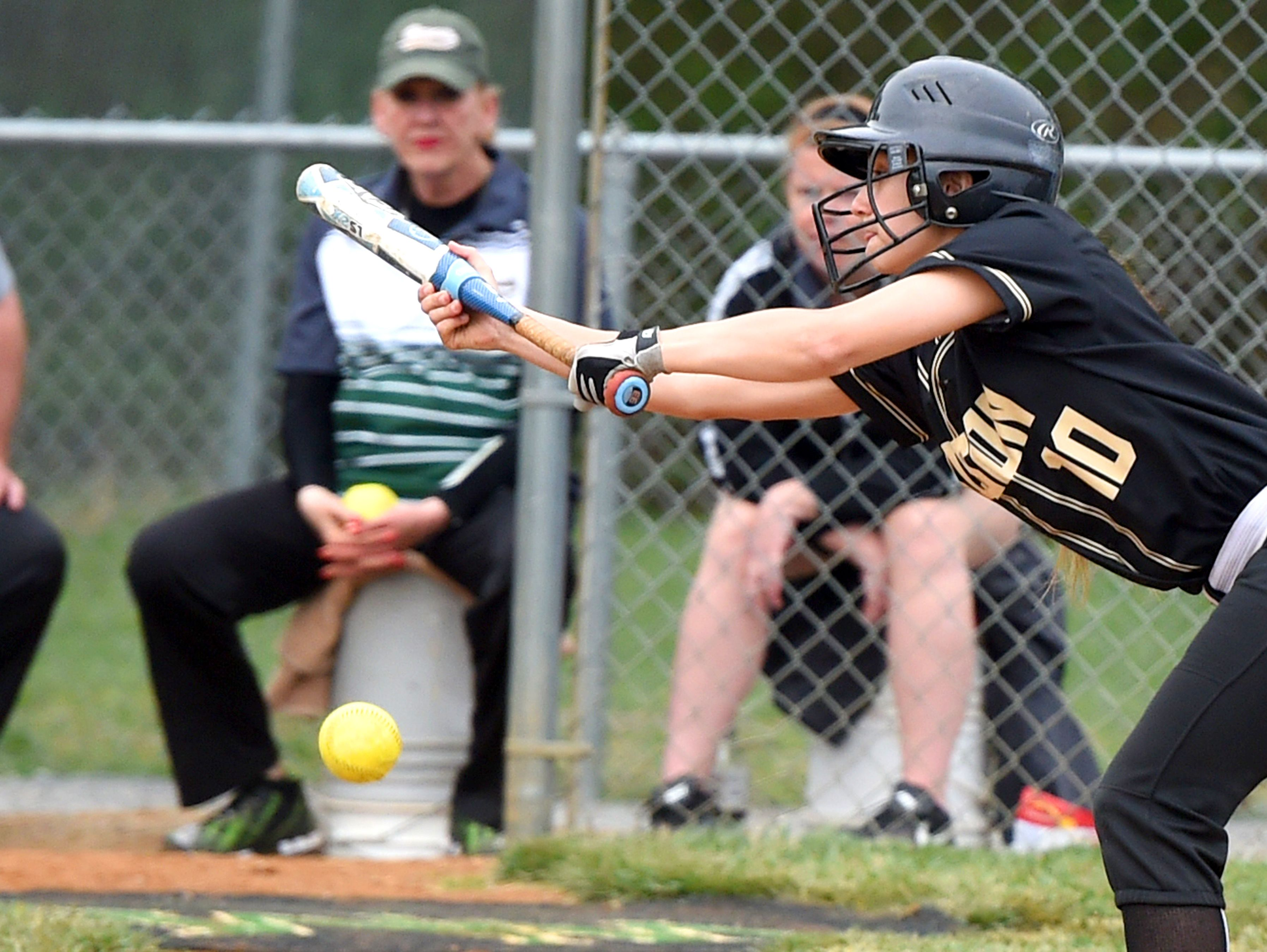 Buffalo Gap's Destiny Harper connects with the ball as she bunts in the second inning during a softball game played in Fishersville on Friday, April 1, 2016.