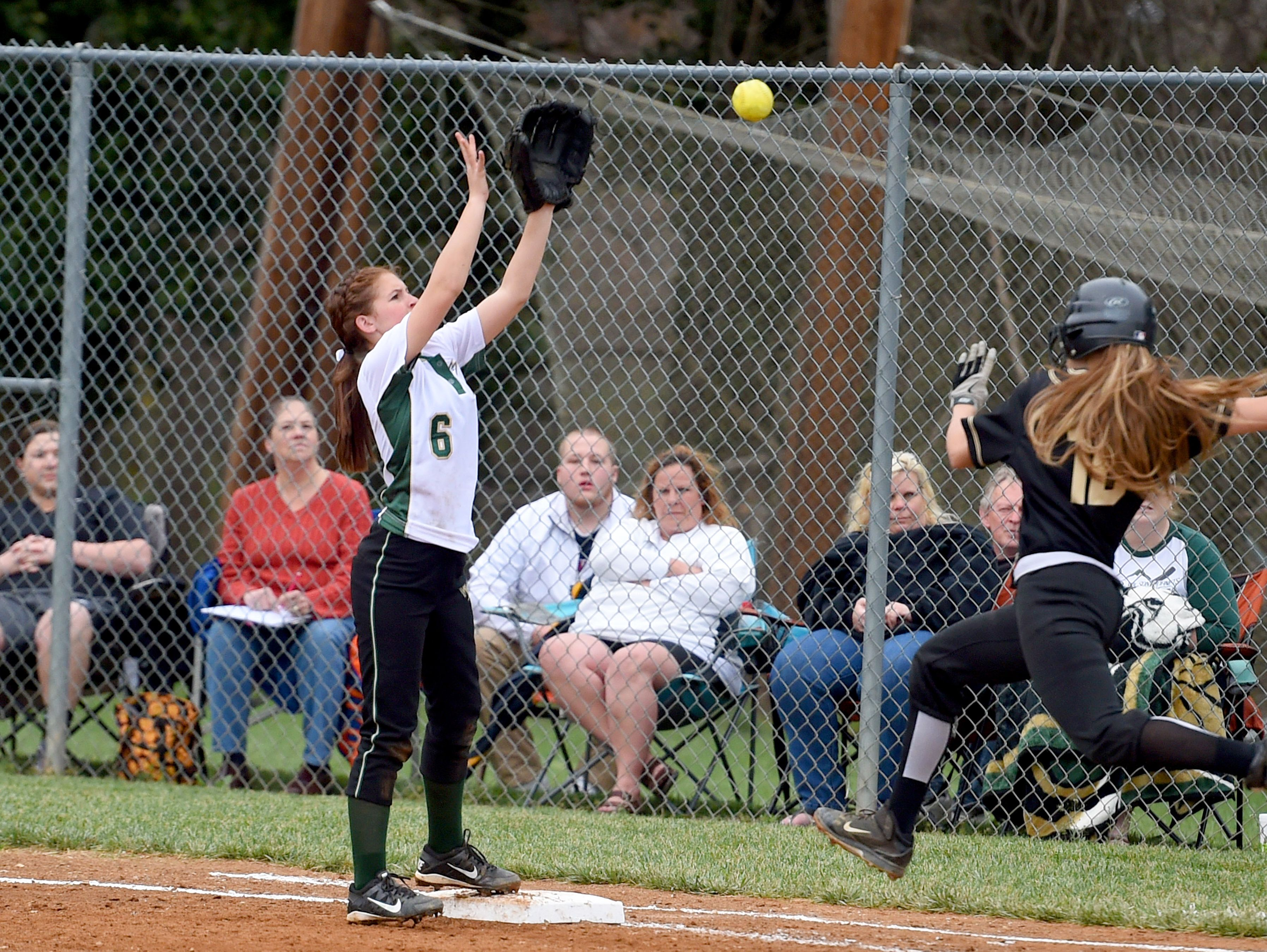 Wilson Memorial's Bri Meek catches the throw to tag out Buffalo Gap's Destiny Harper at first base after Harper bunted in the second inning during a softball game played in Fishersville on Friday, April 1, 2016.