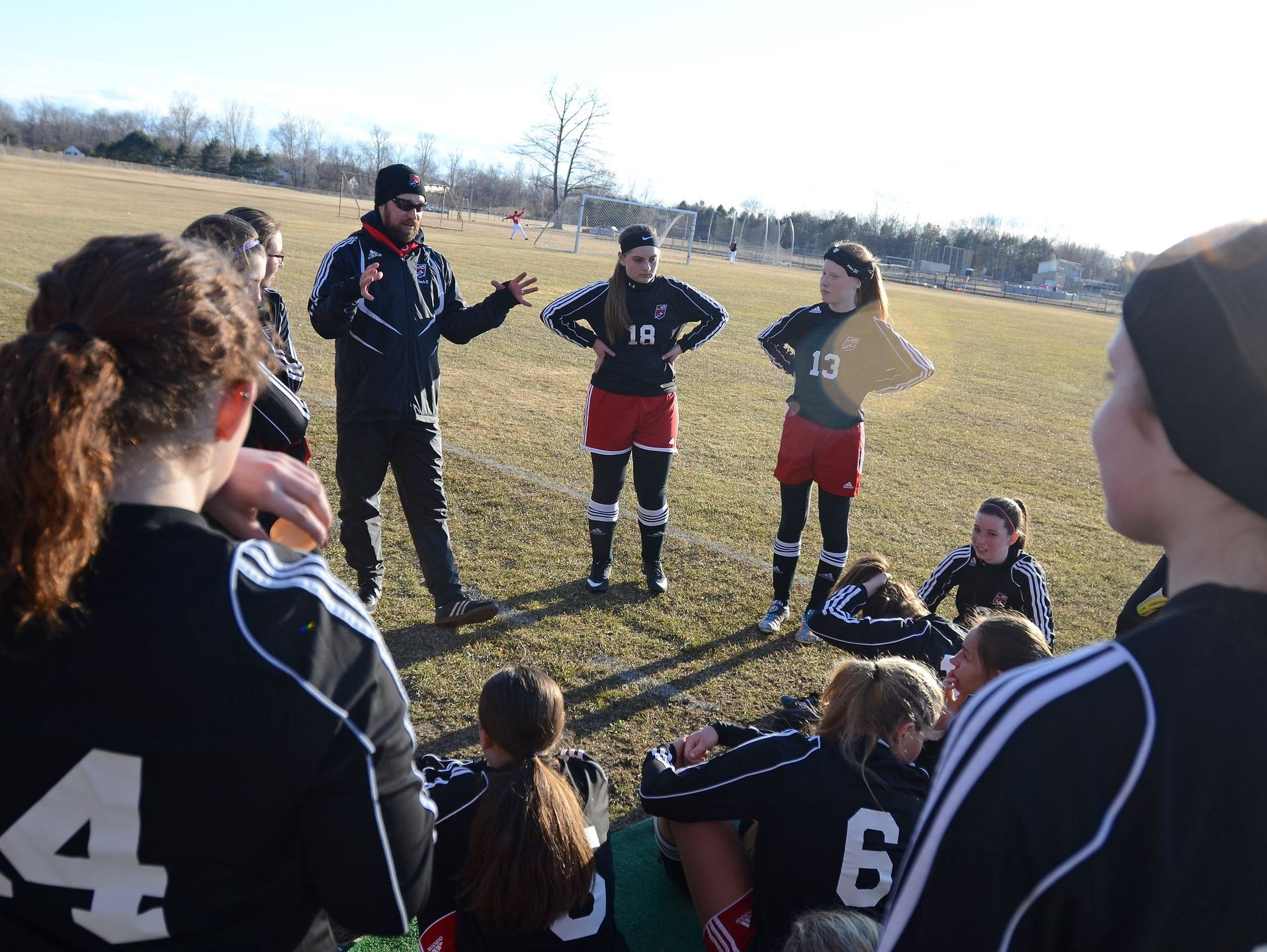 Big Reds' coach, Ryan Kopydlowski, talks to his team during halftime Mon, March 30, 2015 during girls soccer action at Port Huron Northern.