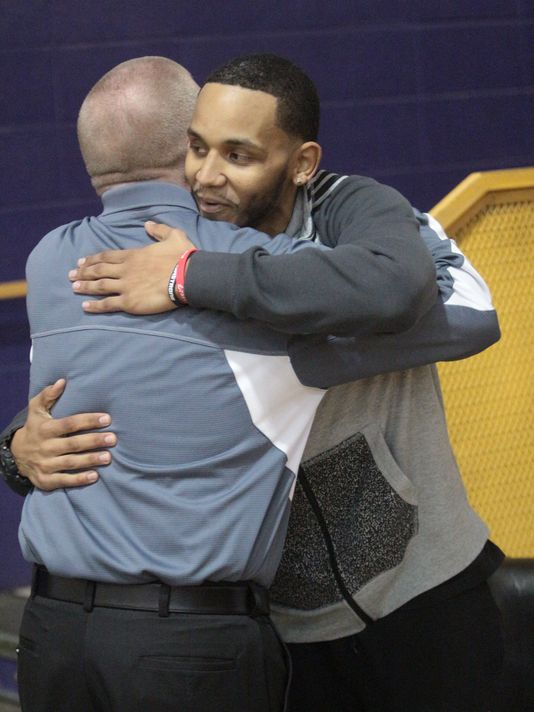 """Josh Artis (right) embraces Kenwood boys' basketball coach Dennis Pardue during the """"Pack the House For Josh"""" night as part of the Kenwood-Clarksville High basketball game last January. (Photo: George Robinson/The Leaf-Chronicle)"""