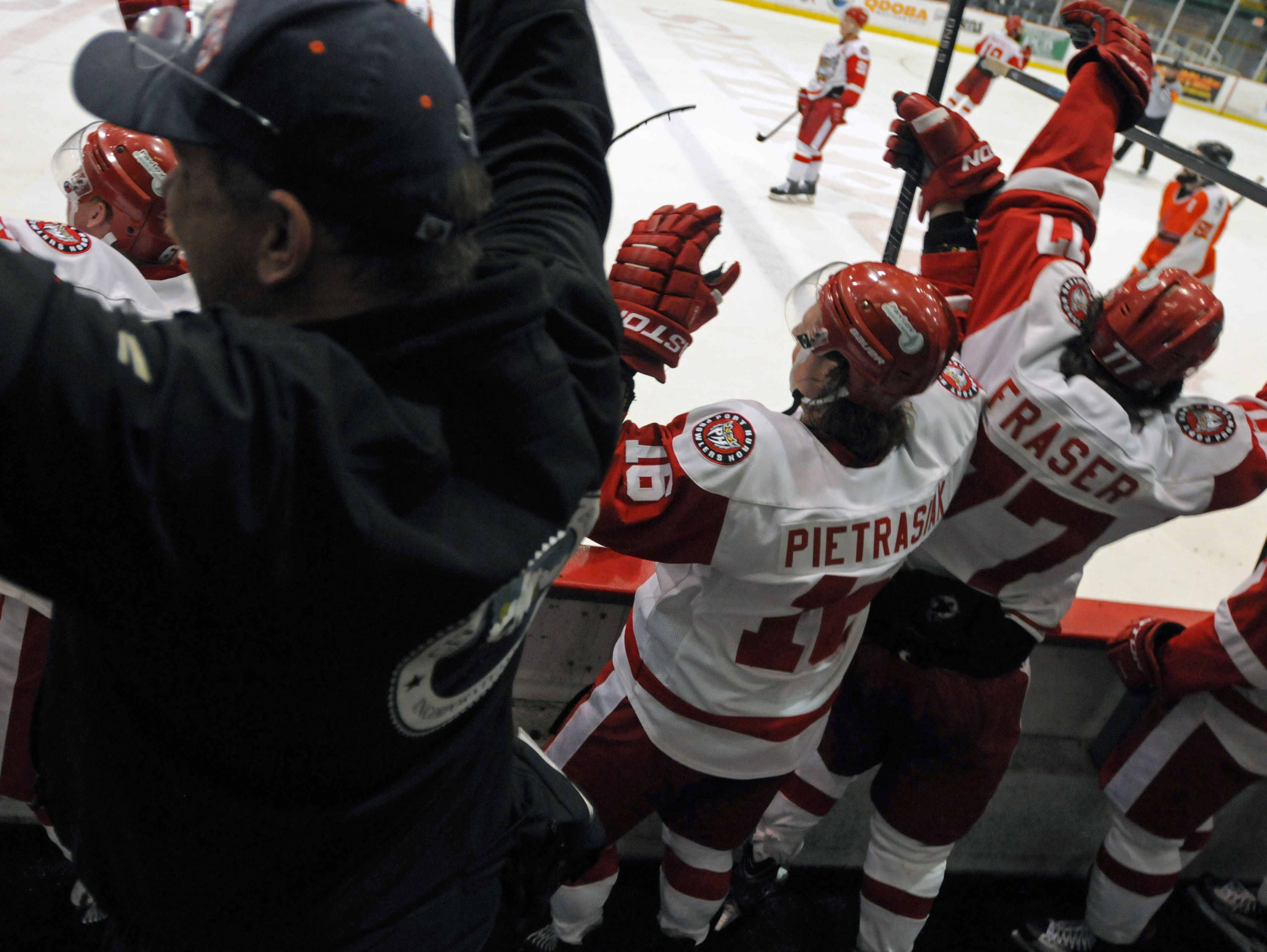 Members of the Port Huron Prowlers celebrate a 6-3 win Sunday, April 10, during an FHL semifinal playoff game at McMorran Arena