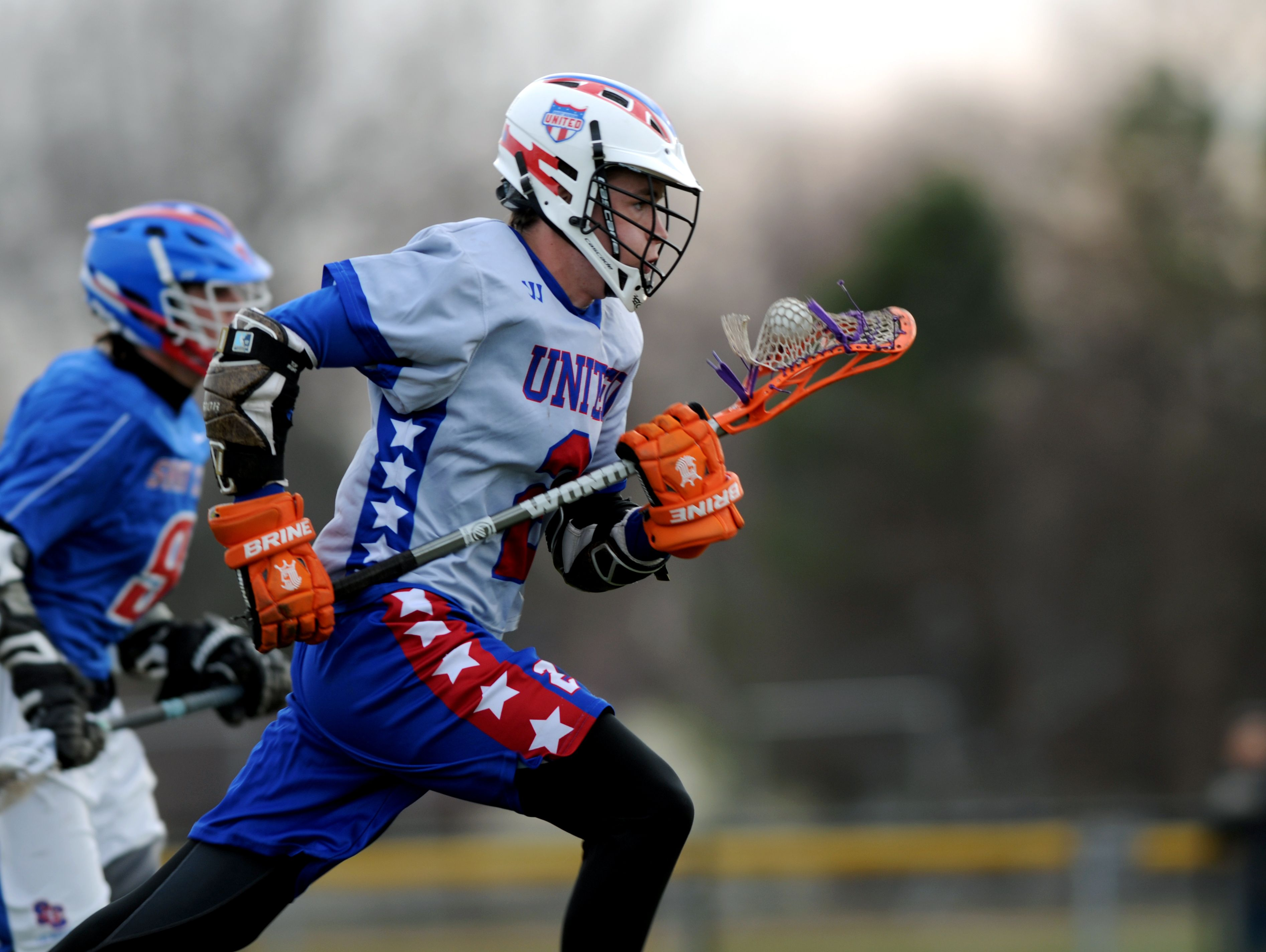 Port Huron United's Austin O'Hare brings the ball up field Monday, April 11, during a Lacrosse match against St. Clair at Port Huron Northern.