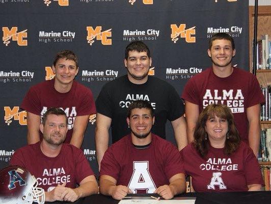 Jacob Headlee celebrates his signing to Alma College football at Marine City High School.