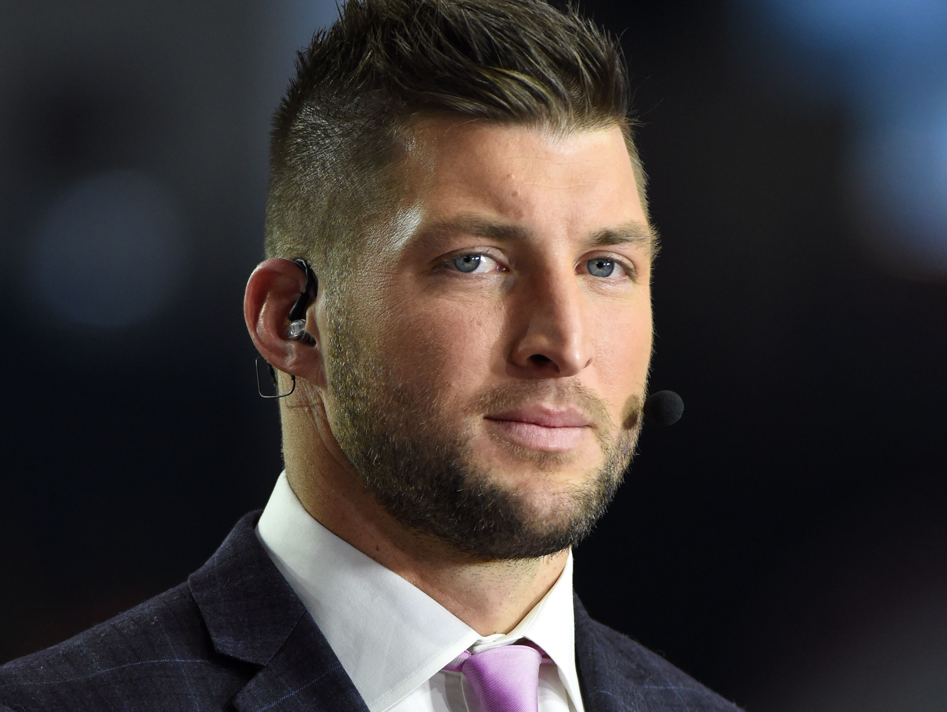 Kirby Lee, USA TODAY Sports Jan 11, 2016; Glendale, AZ, USA; ESPN analyst Tim Tebow before the 2016 CFP National Championship between the Clemson Tigers and the Alabama Crimson Tide at University of Phoenix Stadium. Mandatory Credit: Kirby Lee-USA TODAY Sports ORG XMIT: USATSI-233884 ORIG FILE ID: 20160111_pjc_al2_029.JPG