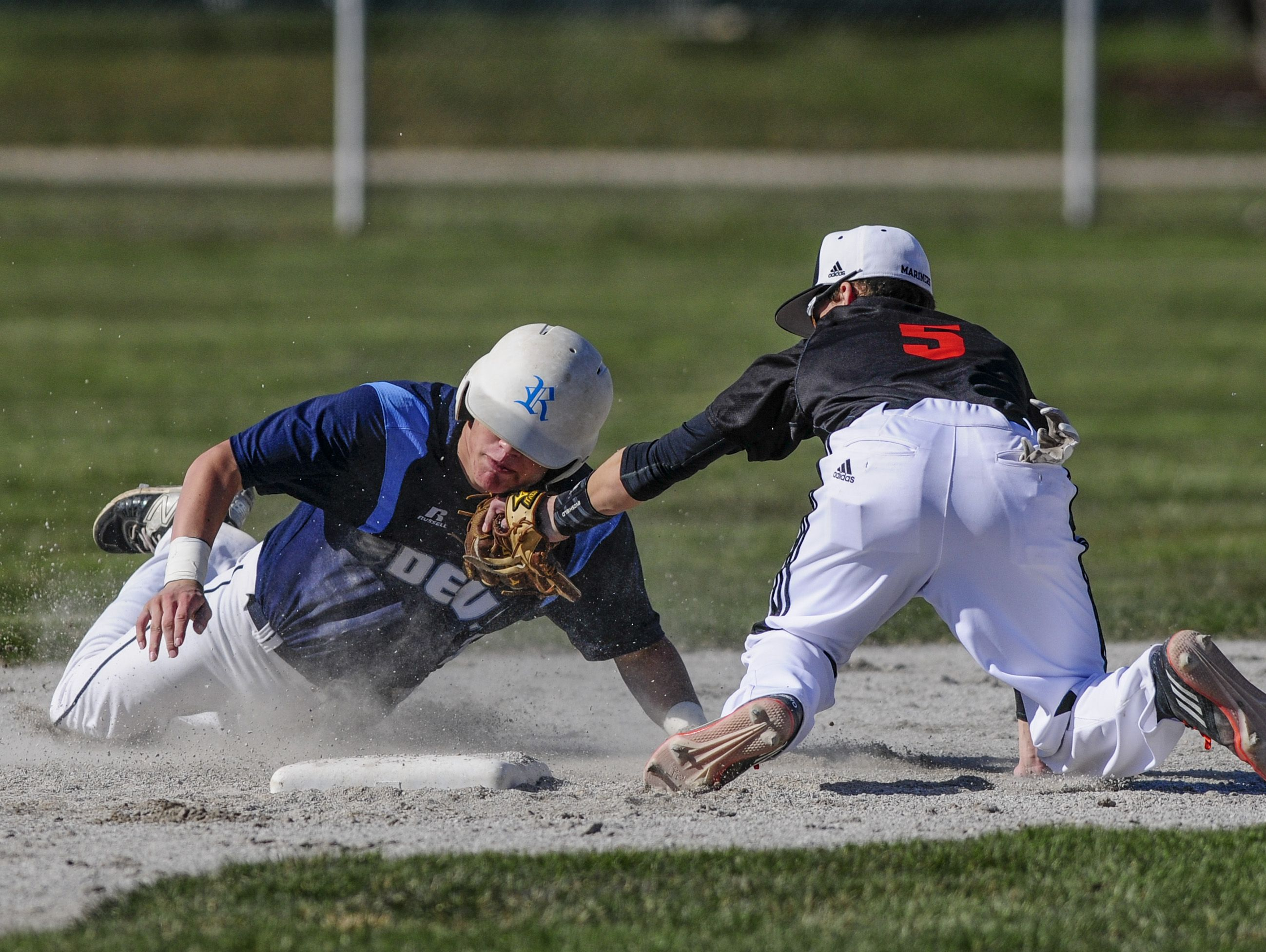 Marine City's Jake Hassein tags out Richmond's Trevor Barrett at second during a baseball game Friday, April 15, 2016 at Marine City High School.
