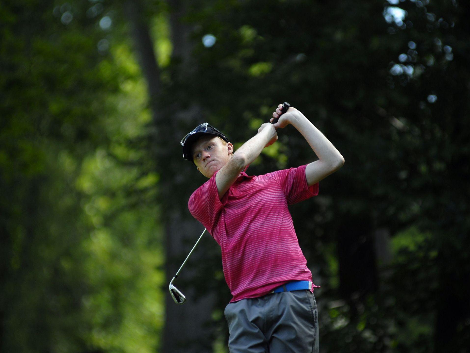 Matt Benson of Lexington, hits a tee shot Monday, Aug 3, during the Blue Water Water Junior Golf Association Tournament of Champions at The Port Huron Elks Golf Club.