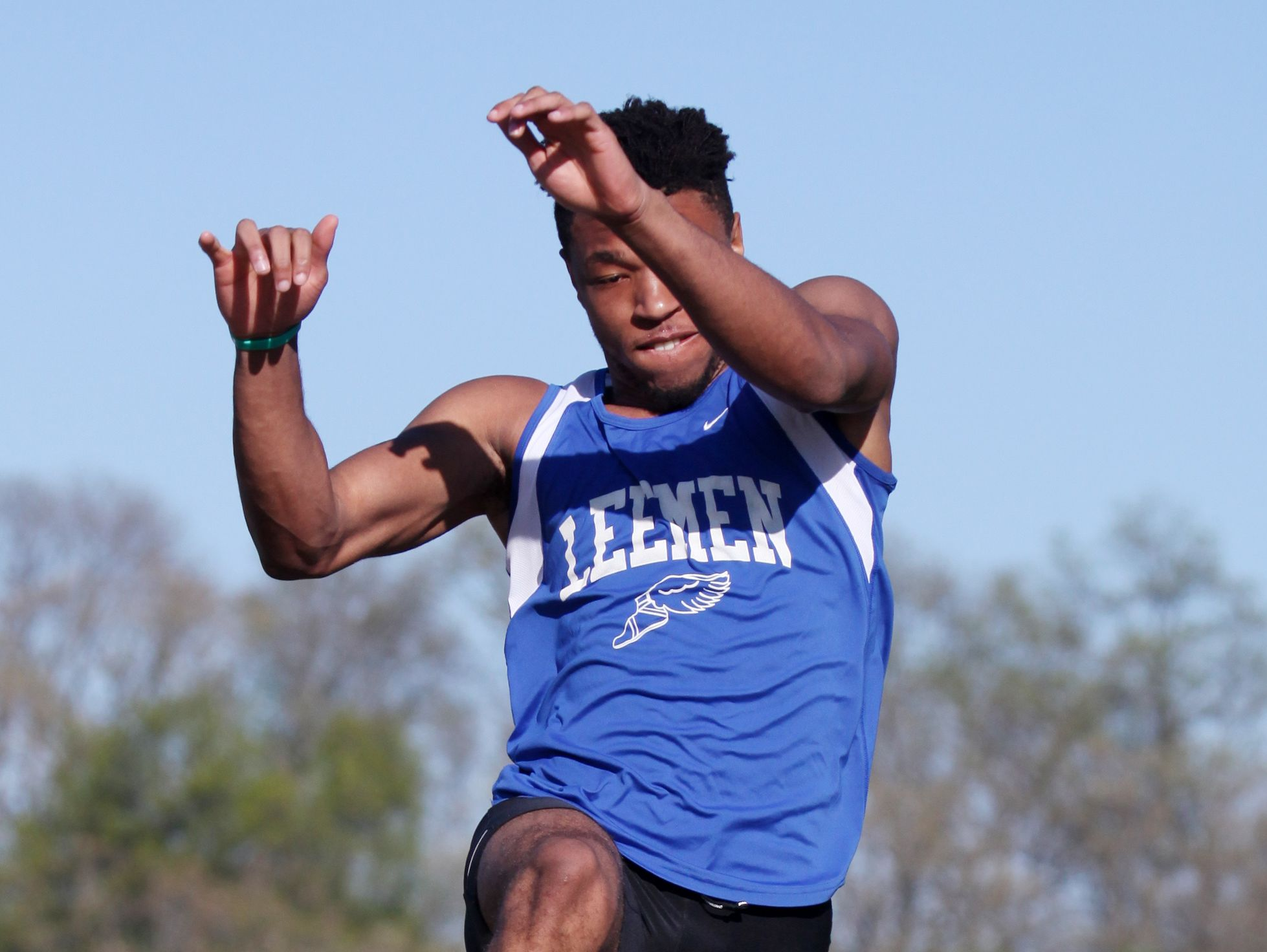 R.E. Lee senior Iyon Oravitz competes in the long jump, winning the event, at the track meet hosted by R.E. Lee on Wednesday, April 20, 2016.