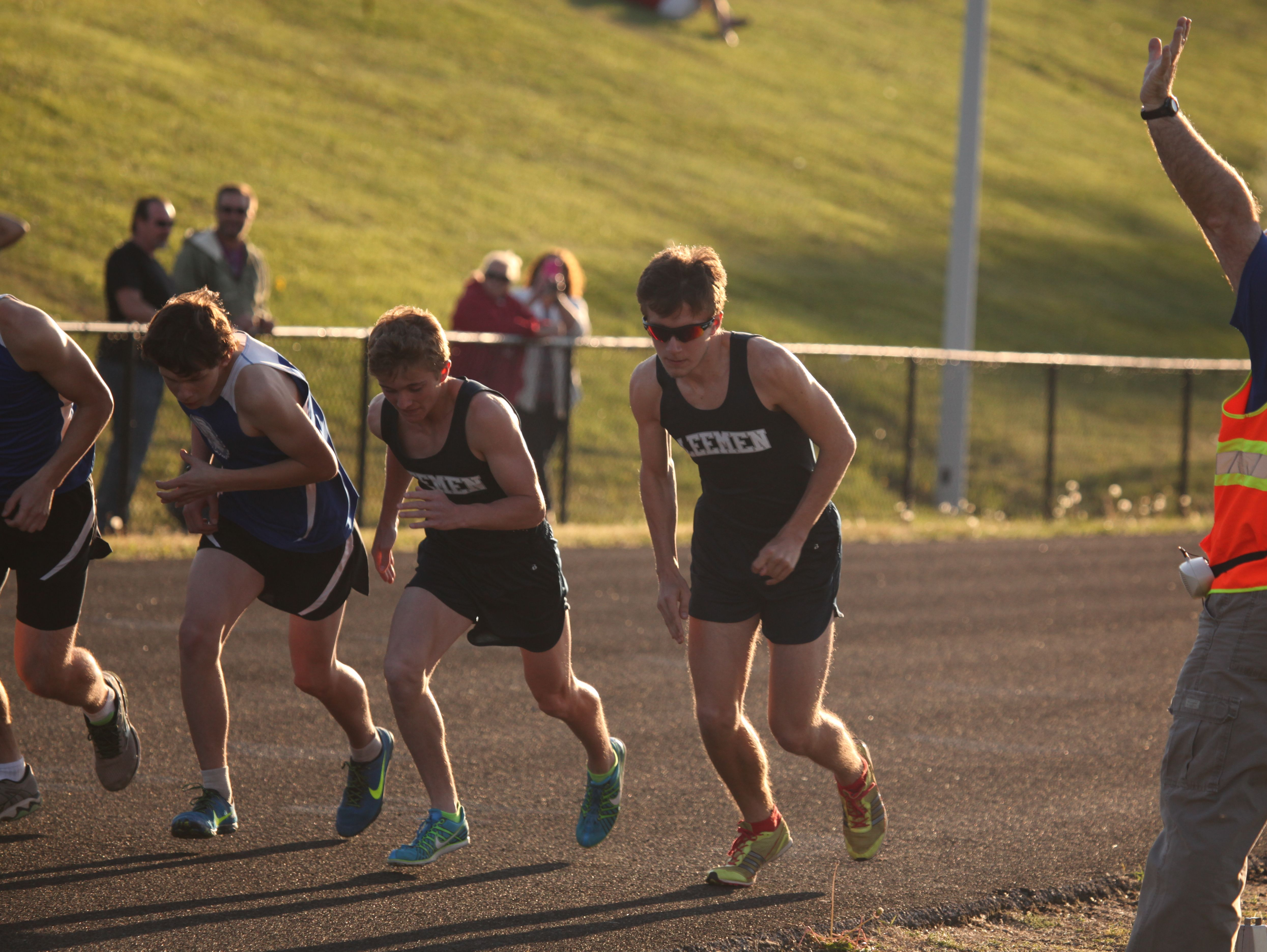 Robert E. Lee's Jacob Warner, right, and Oliver Wilson-Cook, left, take off for the start of the boys 1,600-meter run at Wednesday's Valley District mini meet at Robert E. Lee High School.