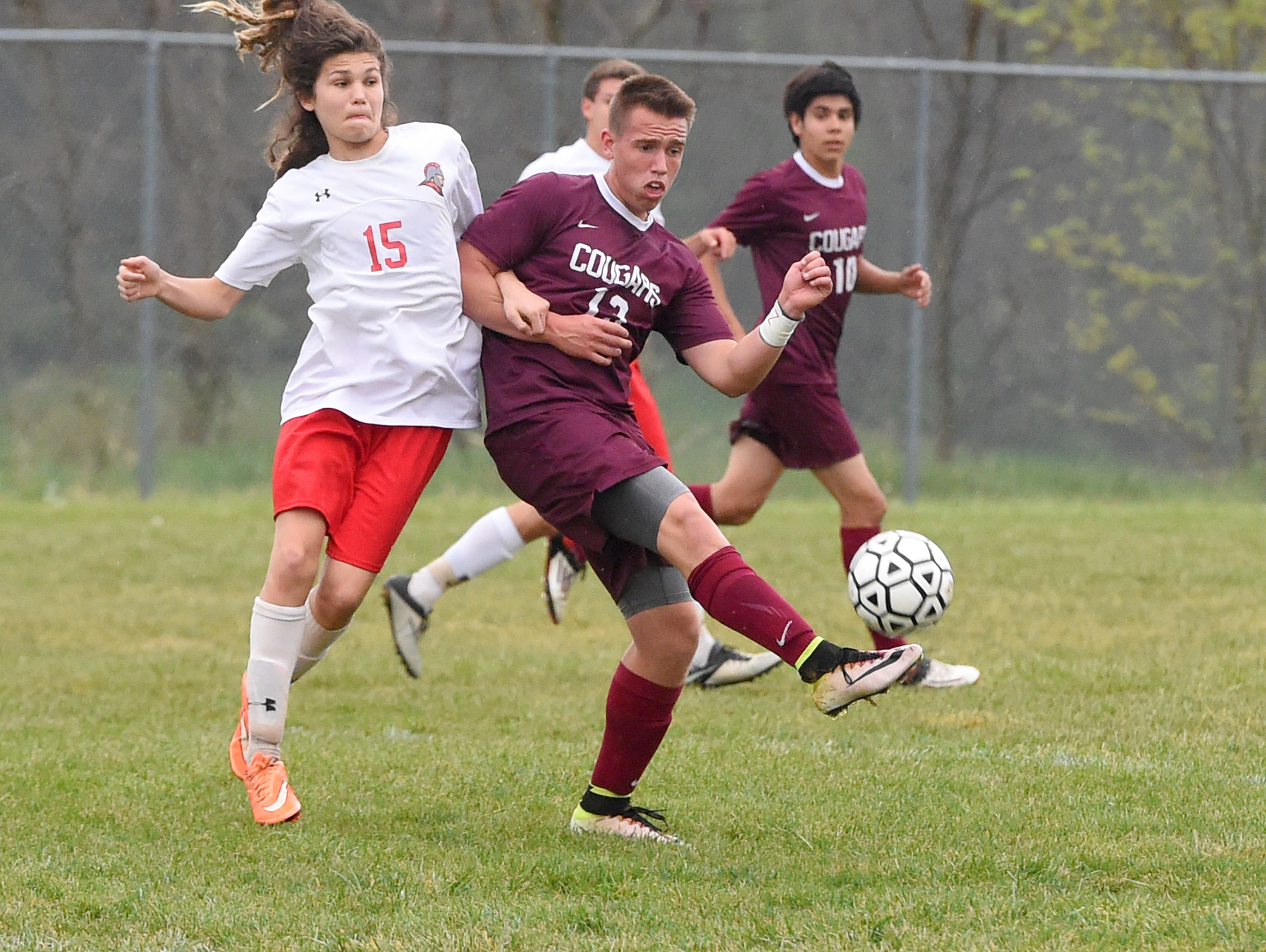 Stuarts Draft's Joshua Huff kicks the ball before Riverheads' Isaiah Knopp during a soccer game played in Greenville on Friday, April 22, 2016.