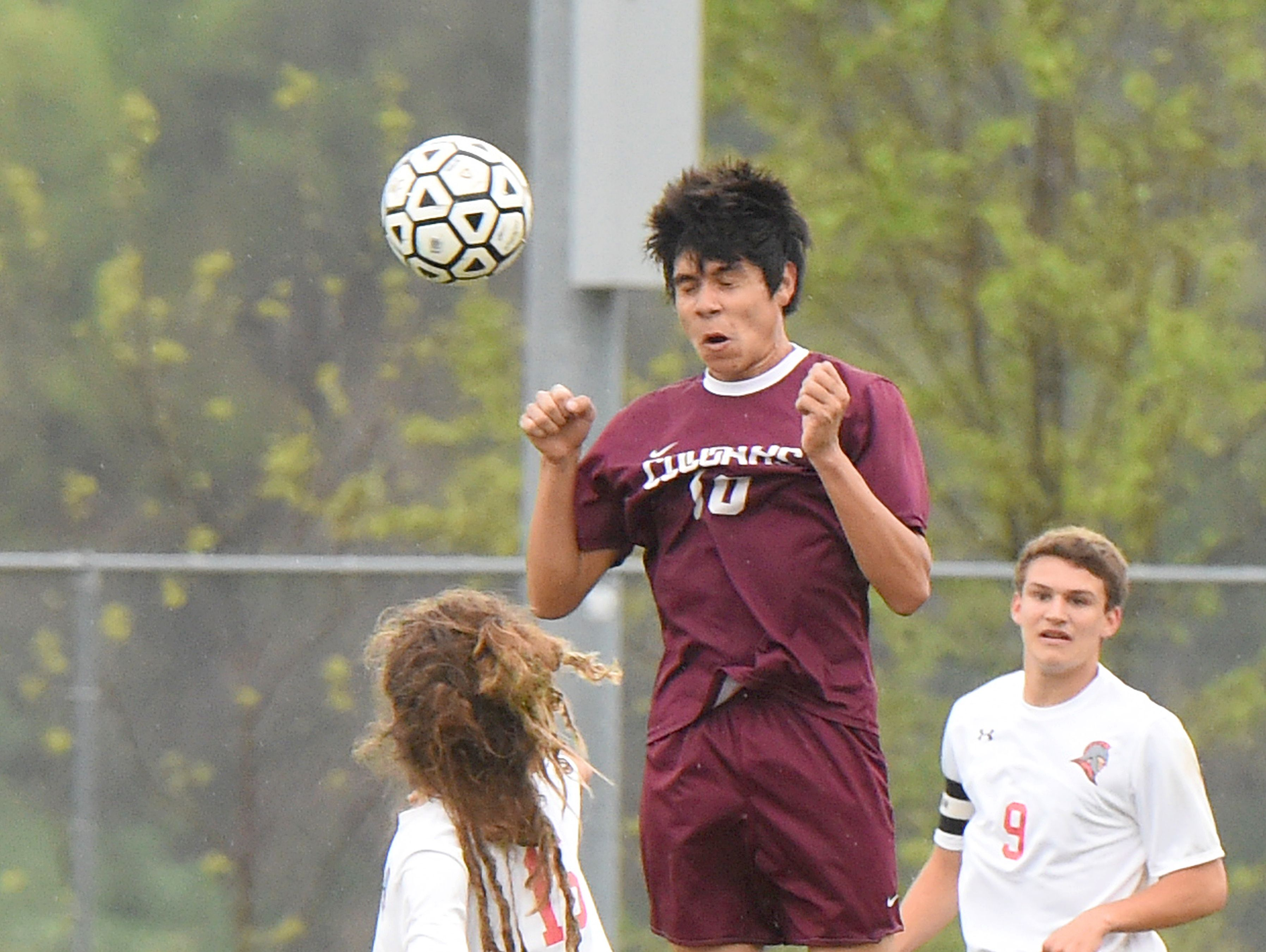 Stuarts Draft's DeyShon Hartley heads the ball during a soccer game played in Greenville on Friday, April 22, 2016.