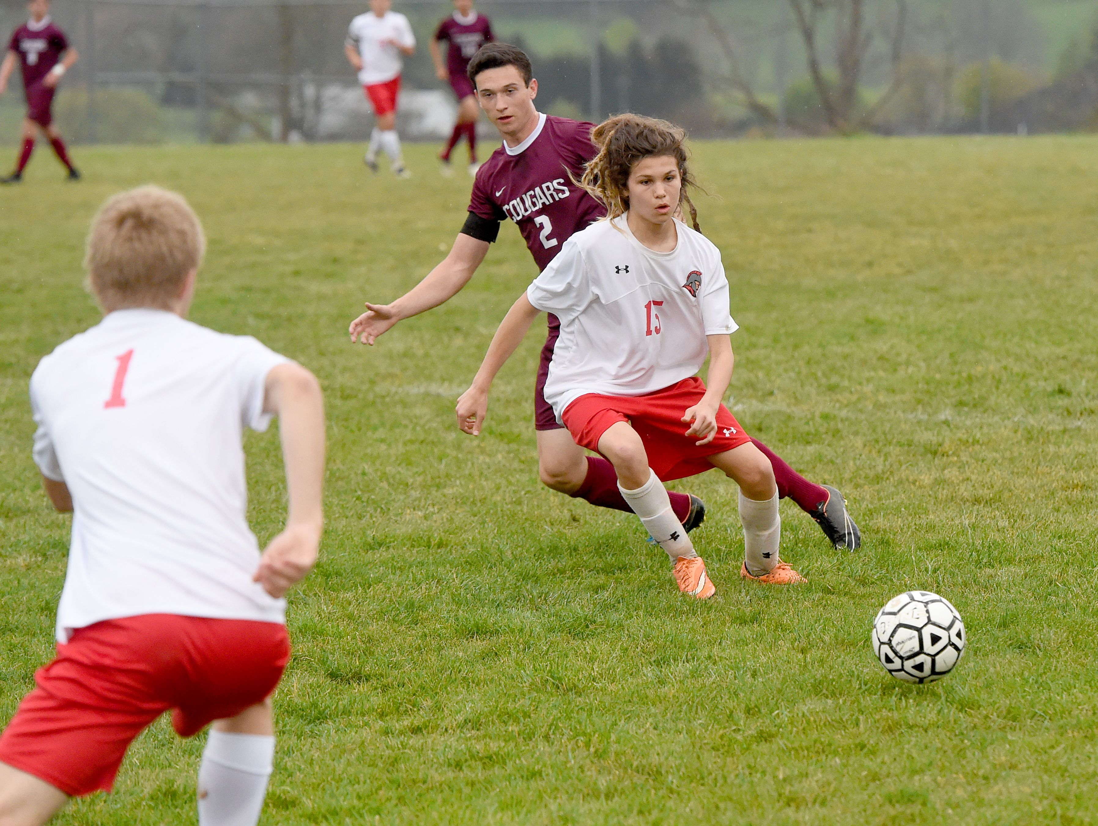 Riverheads' Isaiah Knopp stays between Stuarts Draft's Caleb Oakes and the ball during a soccer game played in Greenville on Friday, April 22, 2016.