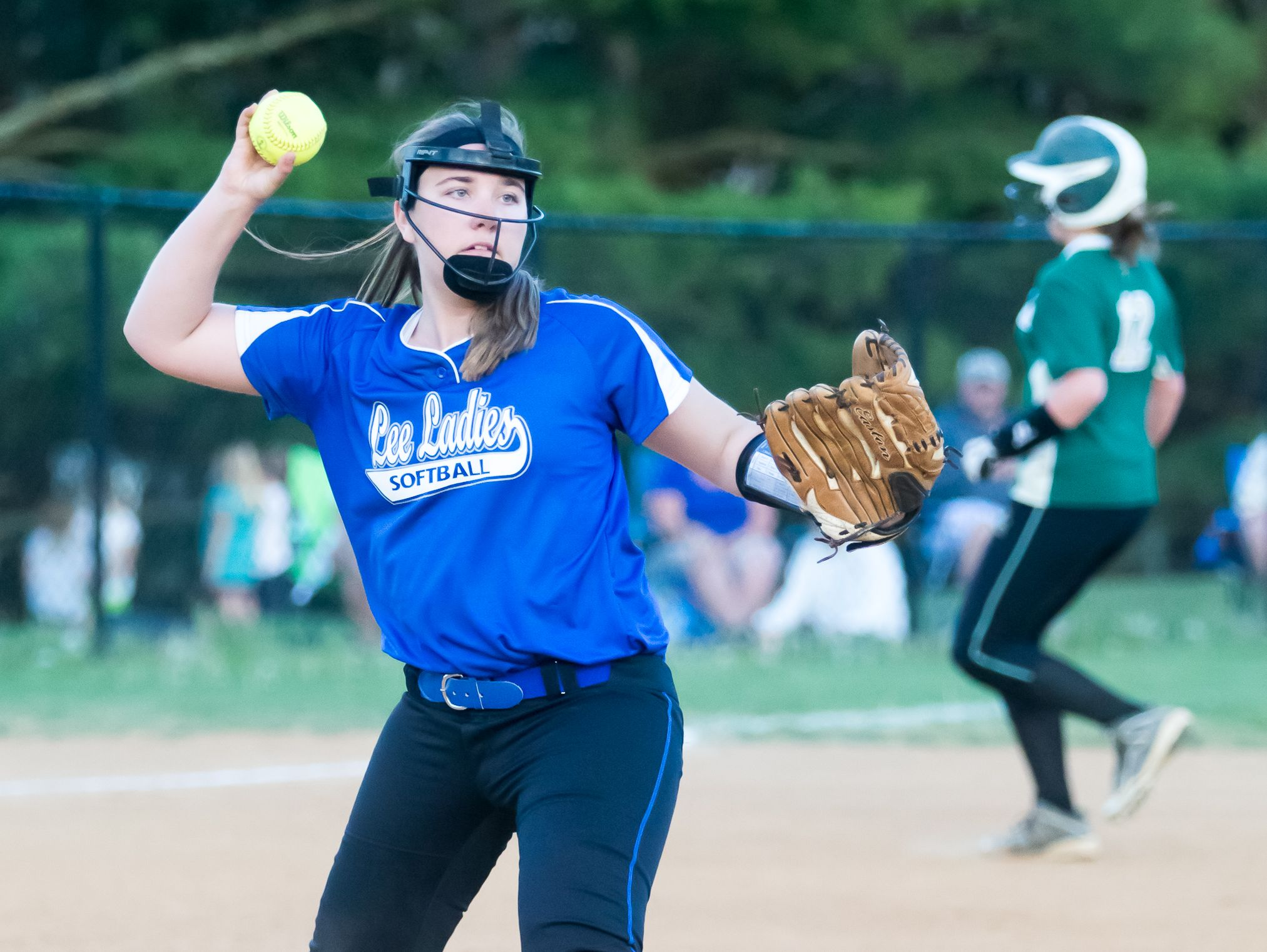 Robert E. Lee's Whitney Darby fires to first for an out during Monday evening's non district softball contest between Wilson Memorial and Robert E. Lee at Montgomery Park.