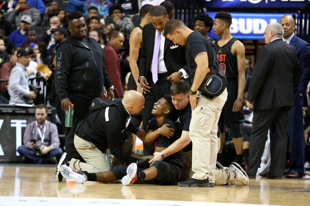 The East team's Alterique Gilbert is seen after suffering an injury against the West team during a high school basketball game in the Jordan Brand Classic on Friday in Brooklyn, NY. (AP Photo, Gregory Payan)