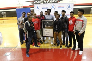 Andrew Jones is joined by his teammates after receiving a Jordan Brand Classic banner (Photo: Jordan Brand Classic)
