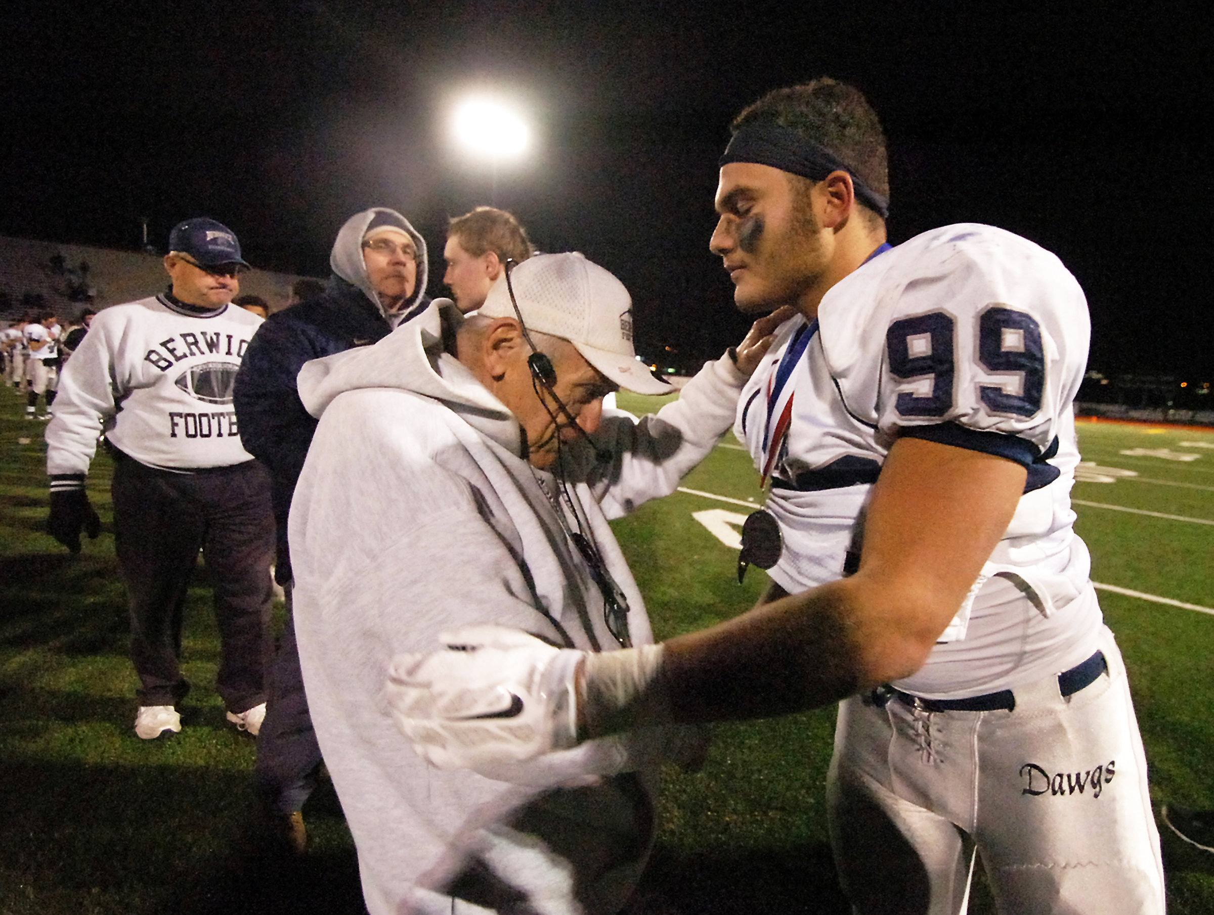 Berwick High School football head coach George Curry, the winningest high school football coach in Pennsylvania history, consoles junior Kyle Roberts after their District 2 Class AAA playoff loss to Scranton Prep (Photo: Butch Comegys, The Times & Tribune via AP)