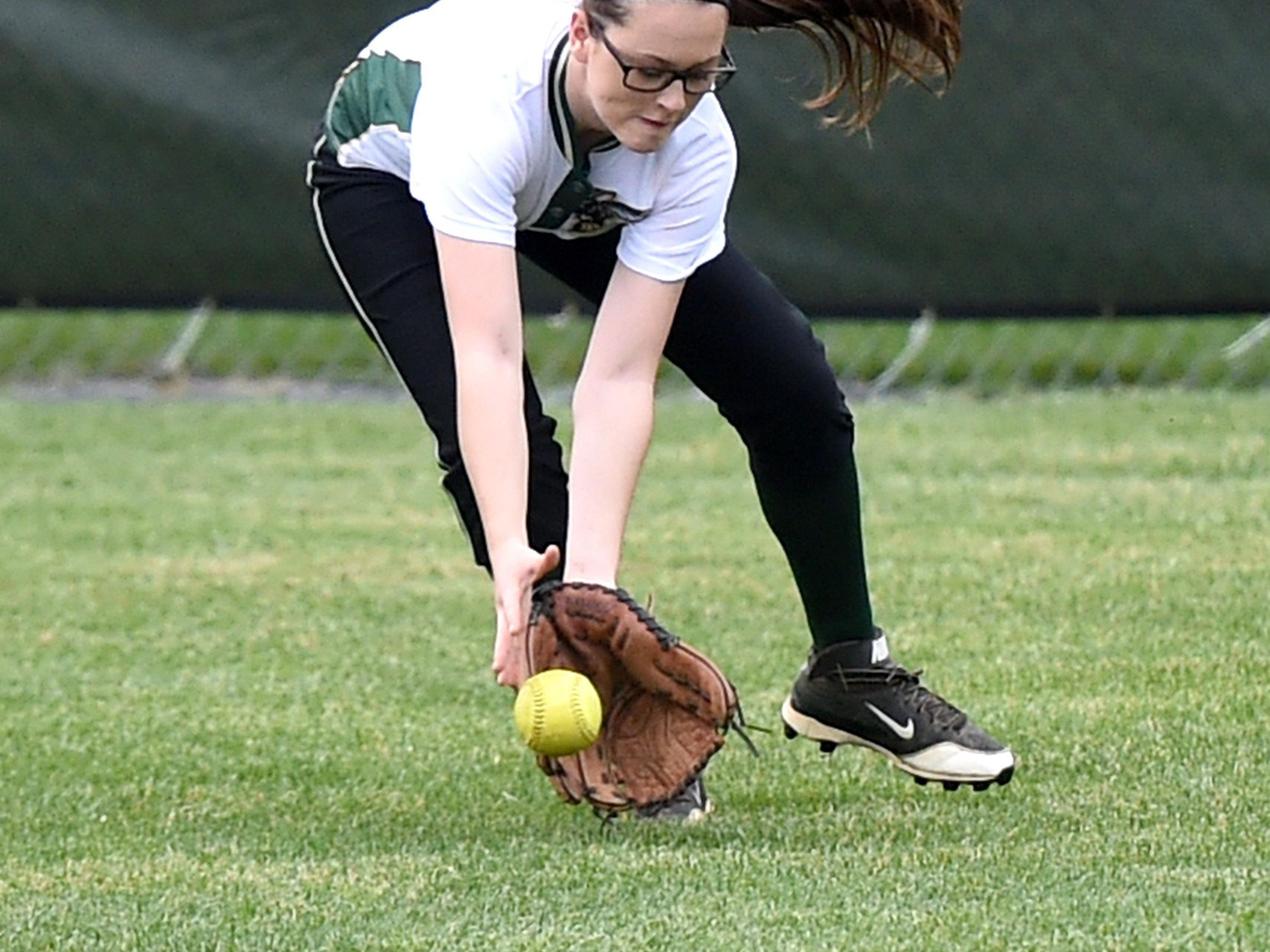 Wilson Memorial's Sarah Brown fields the ball in centerfield and will throw to second base during a softball game played in Fishersville on Friday, April 1, 2016.