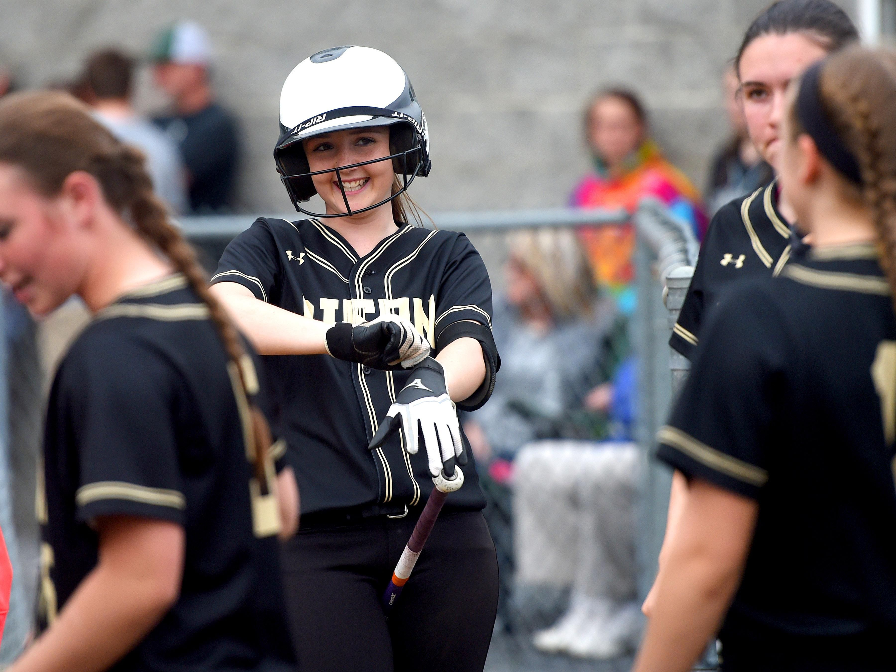 Buffalo Gap's Autumn Stokes smiles as she slips on her batter's gloves at the start of the third inning during a softball game played in Fishersville on Friday, April 1, 2016.