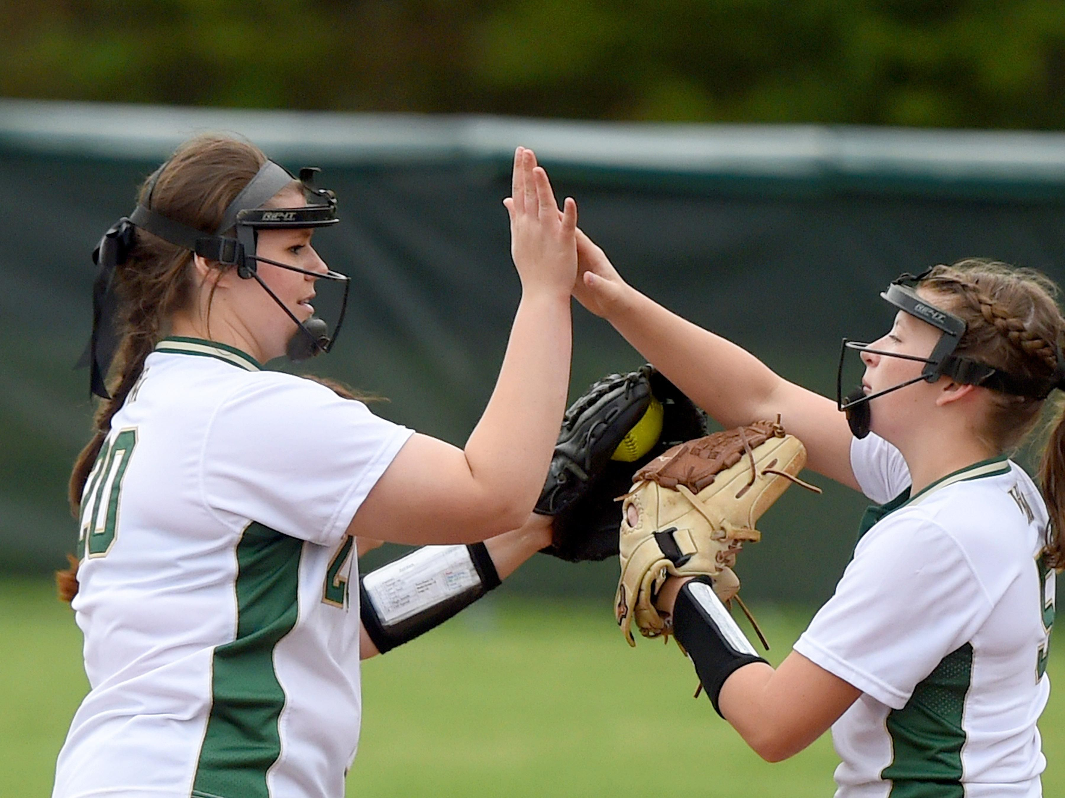 Wilson Memorial pitcher Jordan Sondrol high-fives teammate Emma Peery before taking the pitchers mound at the start of the first inning during a softball game played in Fishersville on Friday, April 1, 2016.