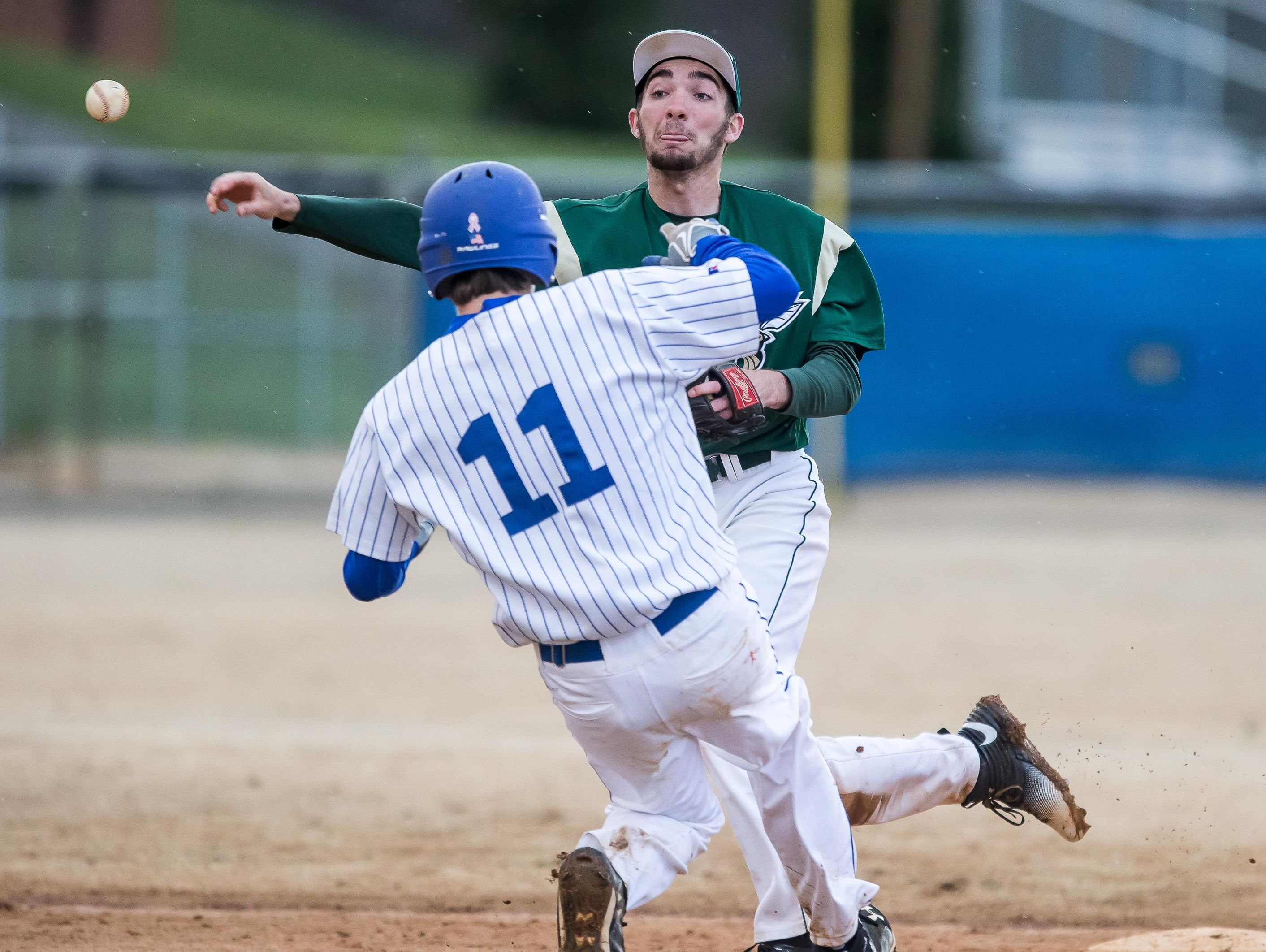 Wilson Memorial shortstop Wayne Pettry fires to first to complete a double play as Fort Defiance's Zach Eppard slides into second during a nonconference baseball game Thursday at Fort Defiance High School.