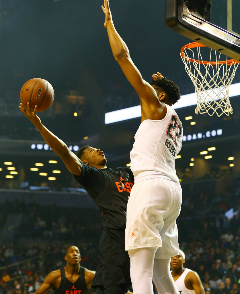West defender Marques Bolden, right, tries to block a shot by East guard Alterique Gilbert during the Jordan Brand Classic Boys National Game at Barclay's Center. (Photo: Andy Marlin-USA TODAY Sports Images).