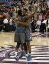 Chino Hills' Elizjah Scott, left, and Onyeka Okongwu celebrate after beating De La Salle 70-50 in the CIF boys' Open Division championship game (Photo: Rich Pedroncelli, Associated Press)