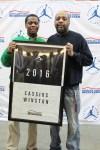 Cassius Winston poses with his father Reginald after receiving his Jordan Brand Classic banner (Photo: Jordan Brand Classic)