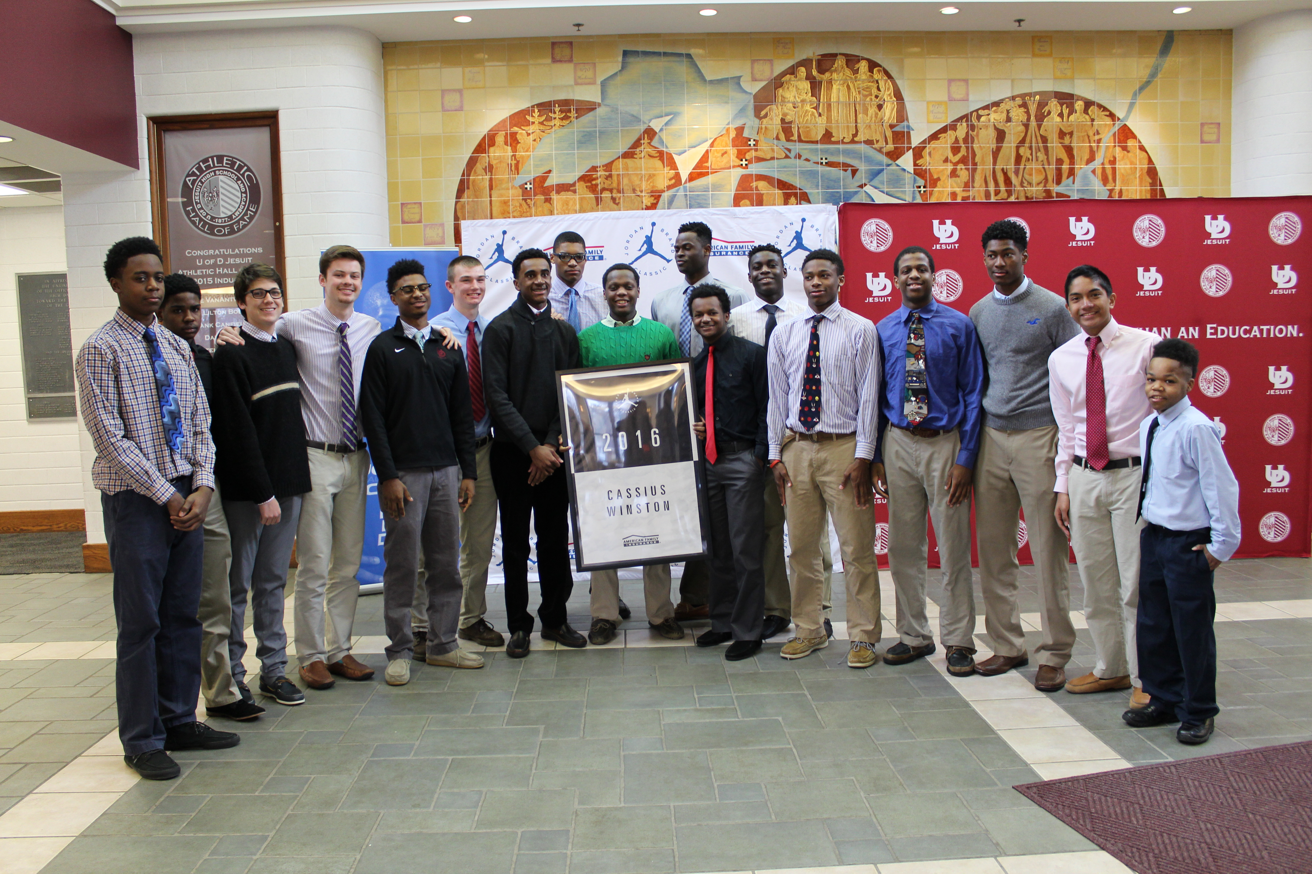 Cassius Winston (center) shares a ceremony for his selection to the Jordan Brand Classic with his teammates at Detroit Jesuit (Photo: Jordan Brand Classic)