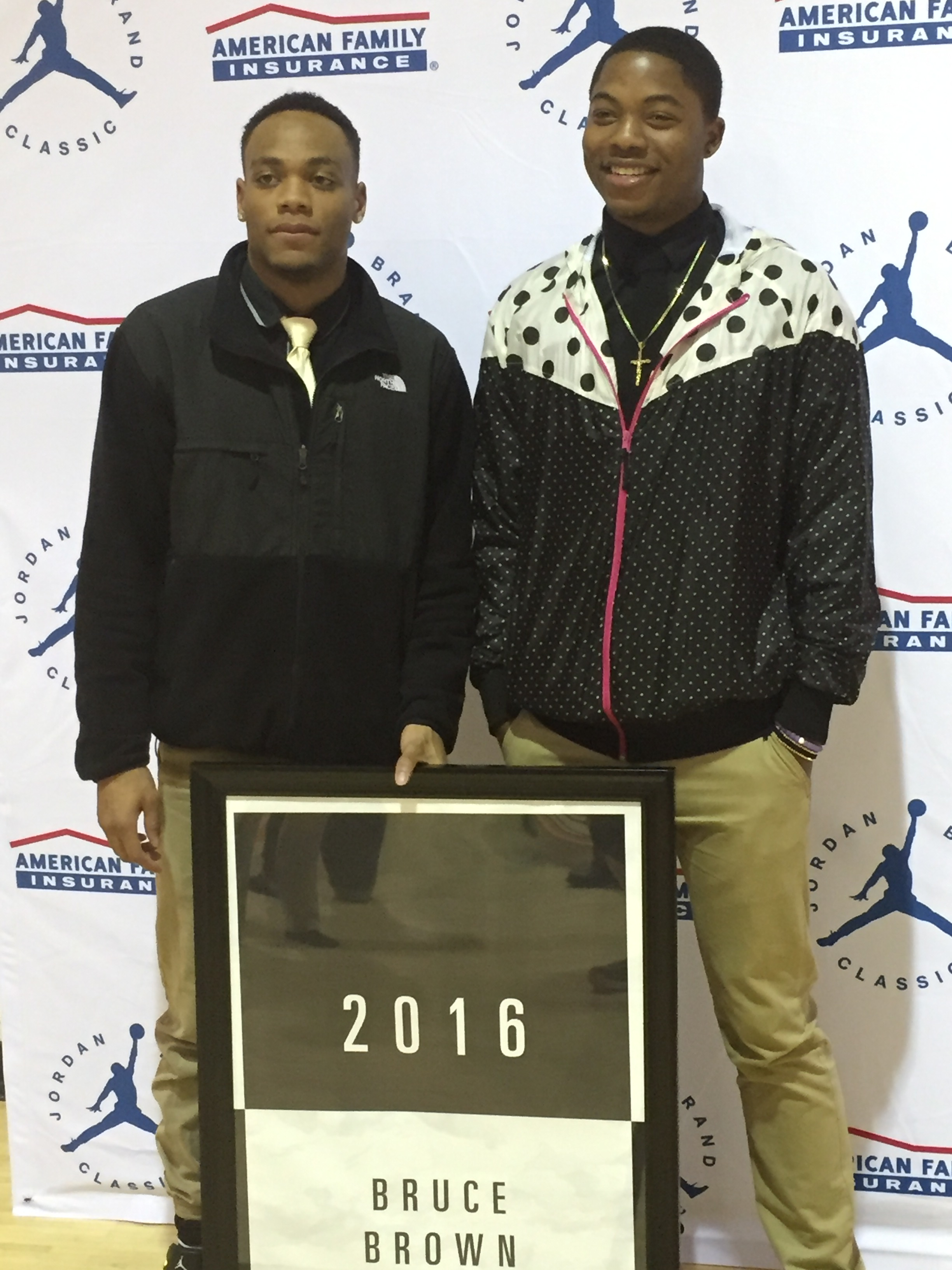 Bruce Brown (left) poses after receiving a banner for the school for making the Jordan Brand Classic (Photo: Jordan Brand Classic)