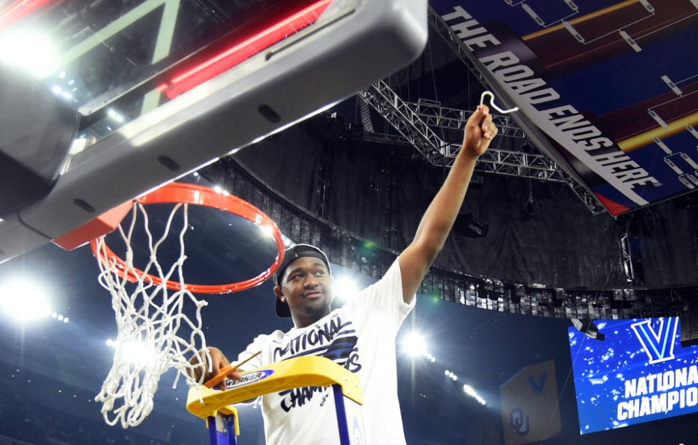 Kris Jenkins cuts down the nets at the NCAA men's basketball championship. The Villanova player was known for his shooting when he played at Gonzaga College Prep (Washington, D.C.). (Photo: Bob Donnan, USA TODAY Sports)